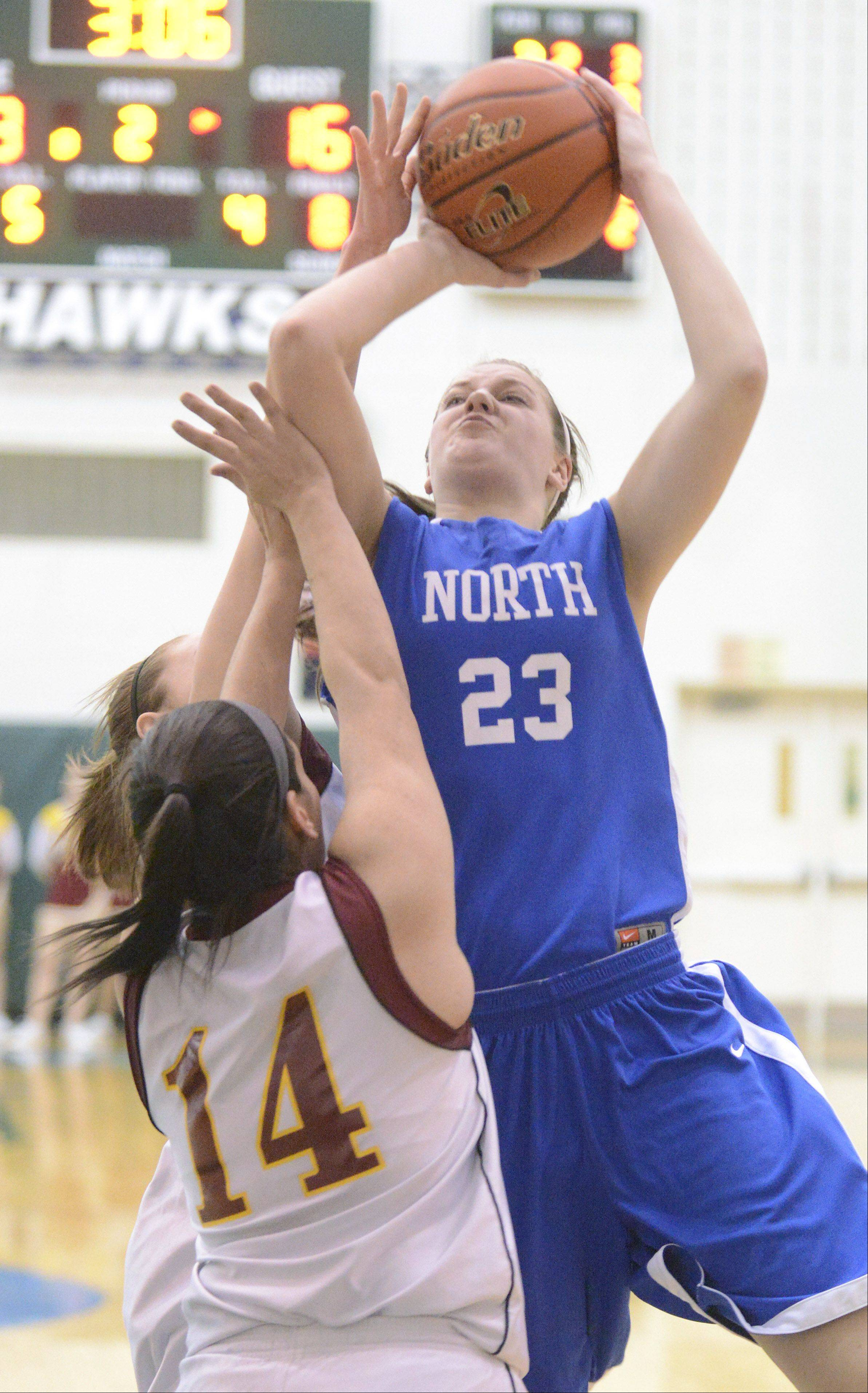 Wheaton North's Chrissy Baird shoots over a block by Schaumburg's Carly Brossard in the second quarter of the Class 4A regional game on Tuesday, February 19.