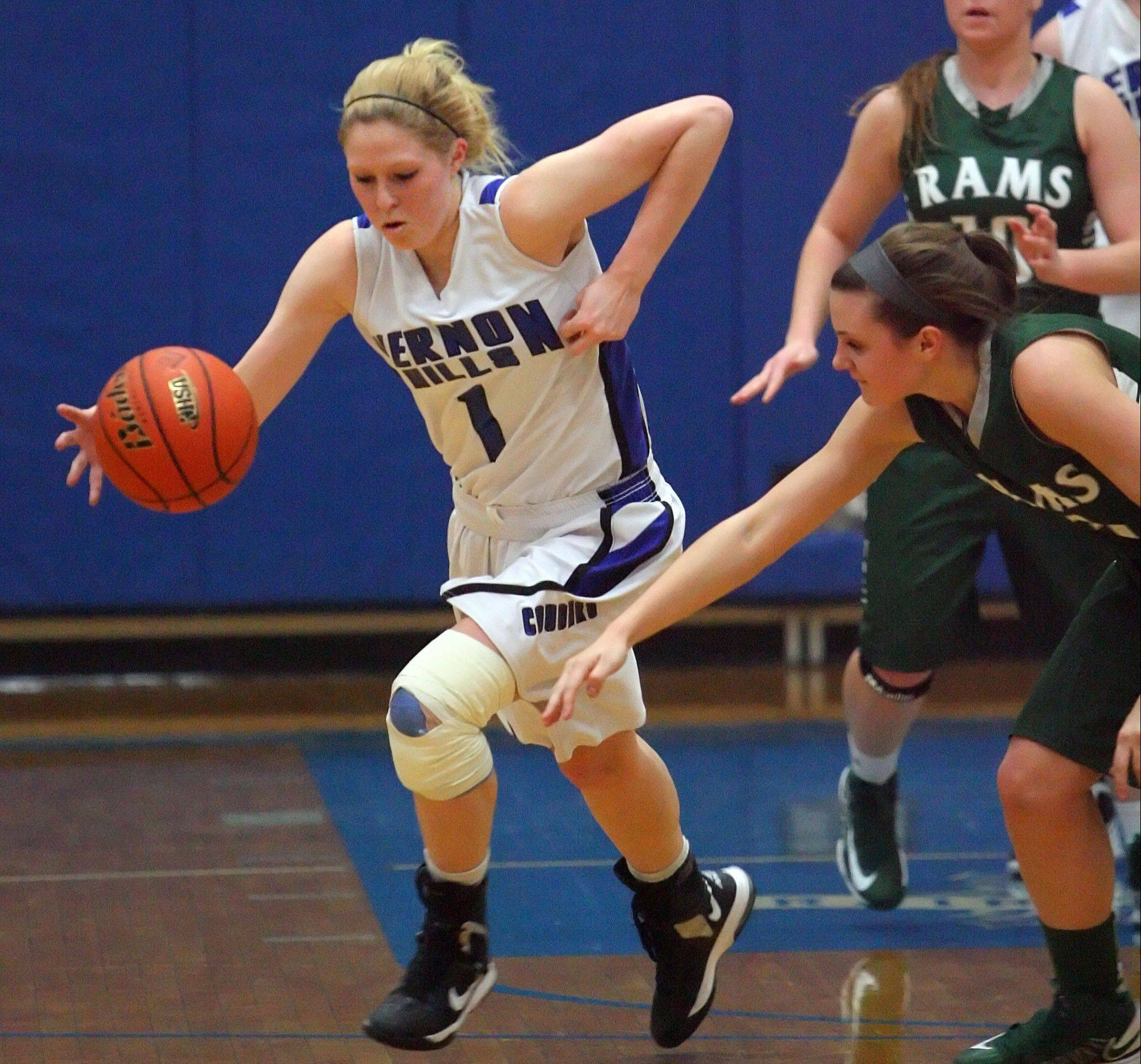 Vernon Hills' Sydney Smith, left steals the ball from Grayslake Central's Savannah Mudd during Class 3A girls basketball sectional semifinal play at Vernon Hills on Tuesday.
