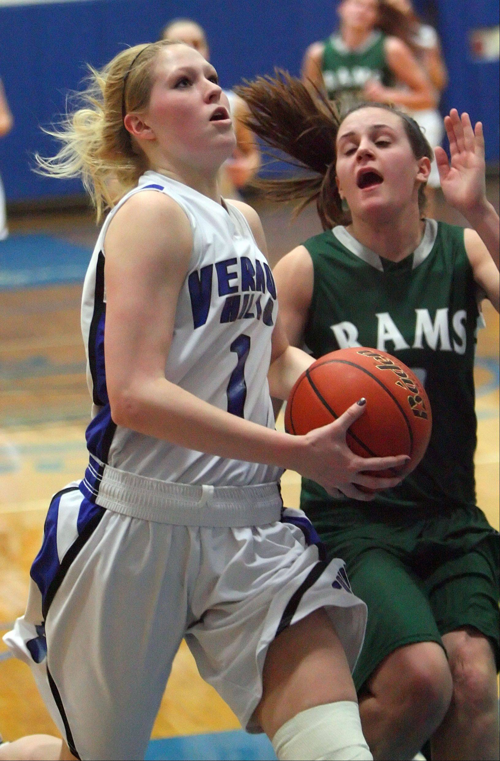 Vernon Hills' Sydney Smith, left drives on Grayslake Central's Savannah Mudd during Class 3A girls basketball sectional semifinal play at Vernon Hills on Tuesday.