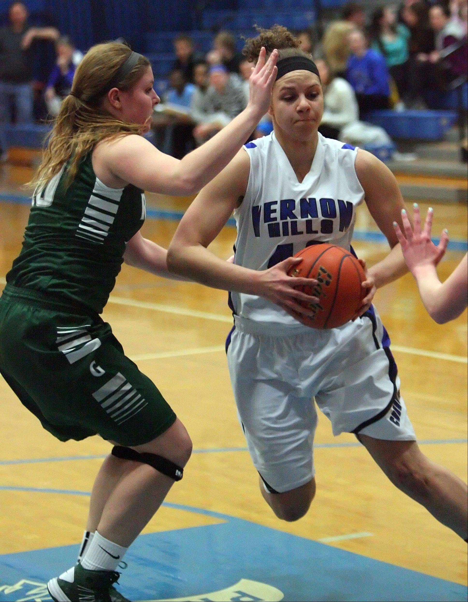 Vernon Hills' Lauren Webb, right, drives on Grayslake Central's Maddy Miller during Class 3A girls basketball sectional semifinal play at Vernon Hills on Tuesday.