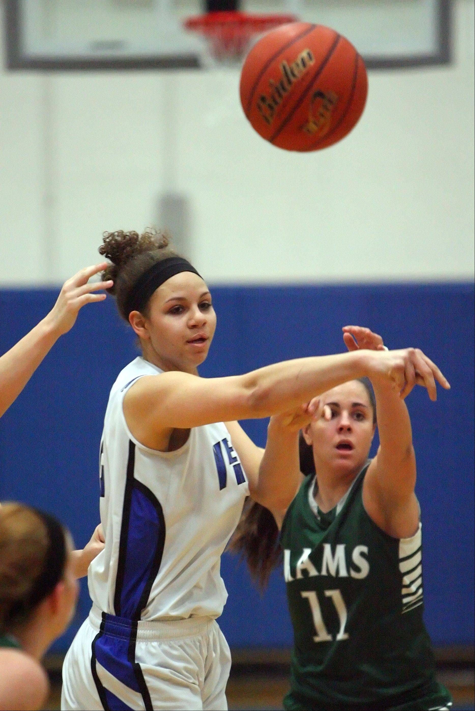 Vernon Hills' left, passes around Grayslake Central's Carson Sparkman during Class 3A girls basketball sectional semifinal play at Vernon Hills on Tuesday.