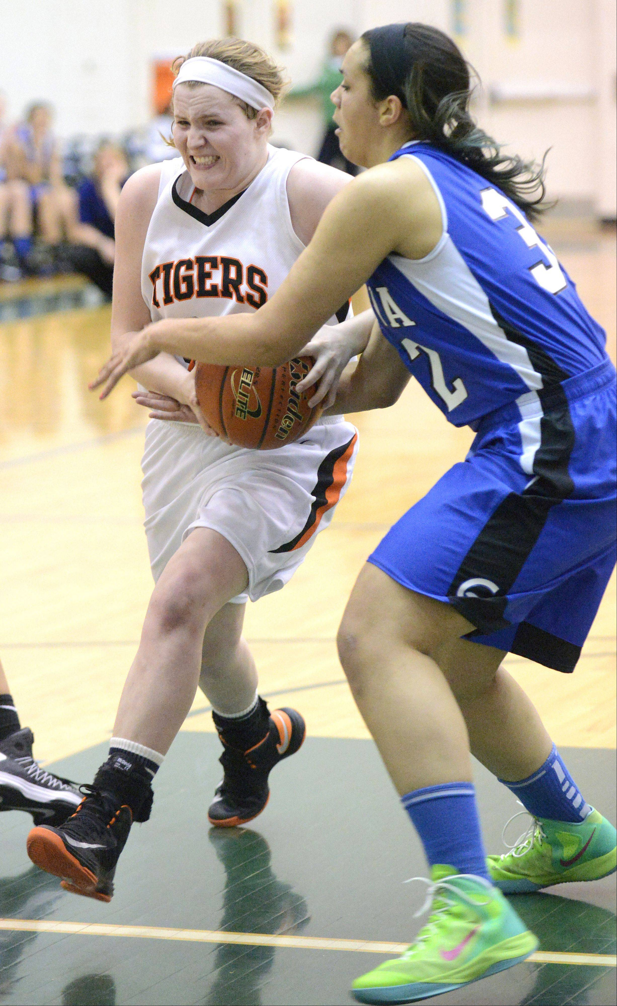 Wheaton Warrenville South's Olivia Linebarger pushes past Geneva's Sidney Santos in a drive for the hoop in the fourth quarter of the Class 4A sectional semifinals on Tuesday, February 19.
