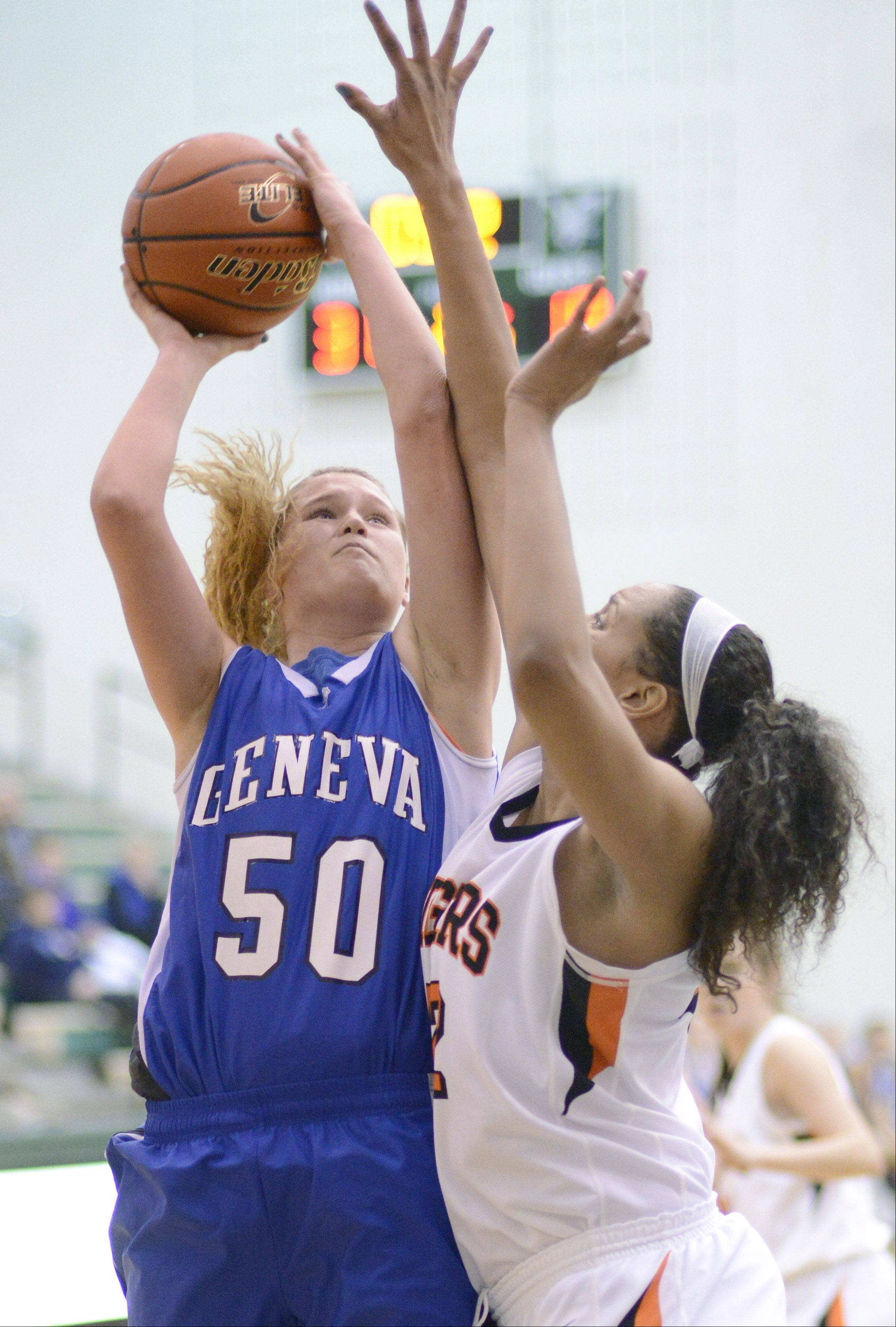 Geneva's Janie McCloughan shoots over Wheaton Warrenville South's Diamond Thompson in the second quarter of the Class 4A sectional semifinals on Tuesday, February 19.