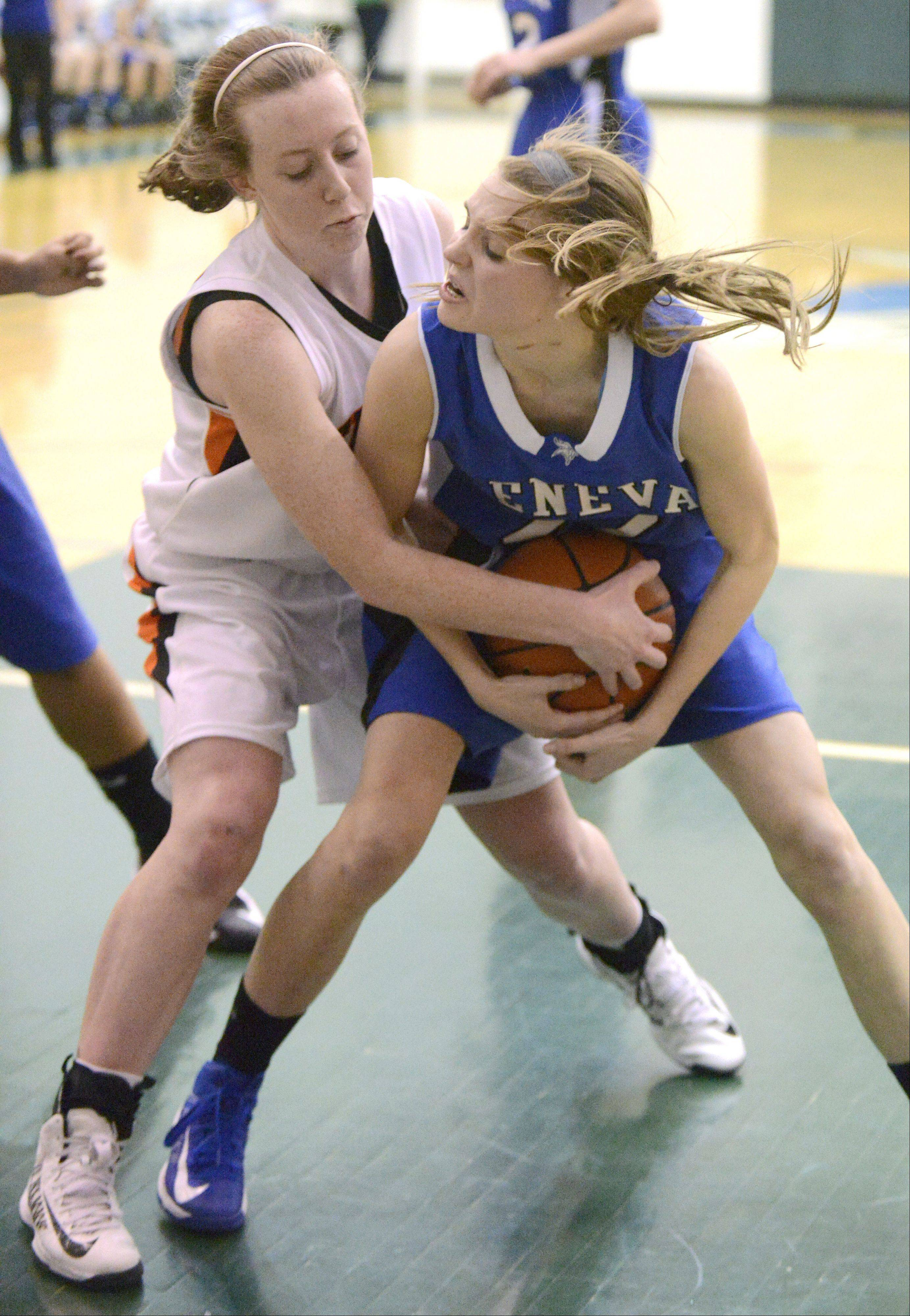 Geneva's Morgan Seberger struggles to keep a rebound from Wheaton Warrenville South's Meghan Waldron in the fourth quarter of the Class 4A sectional semifinals on Tuesday, February 19.