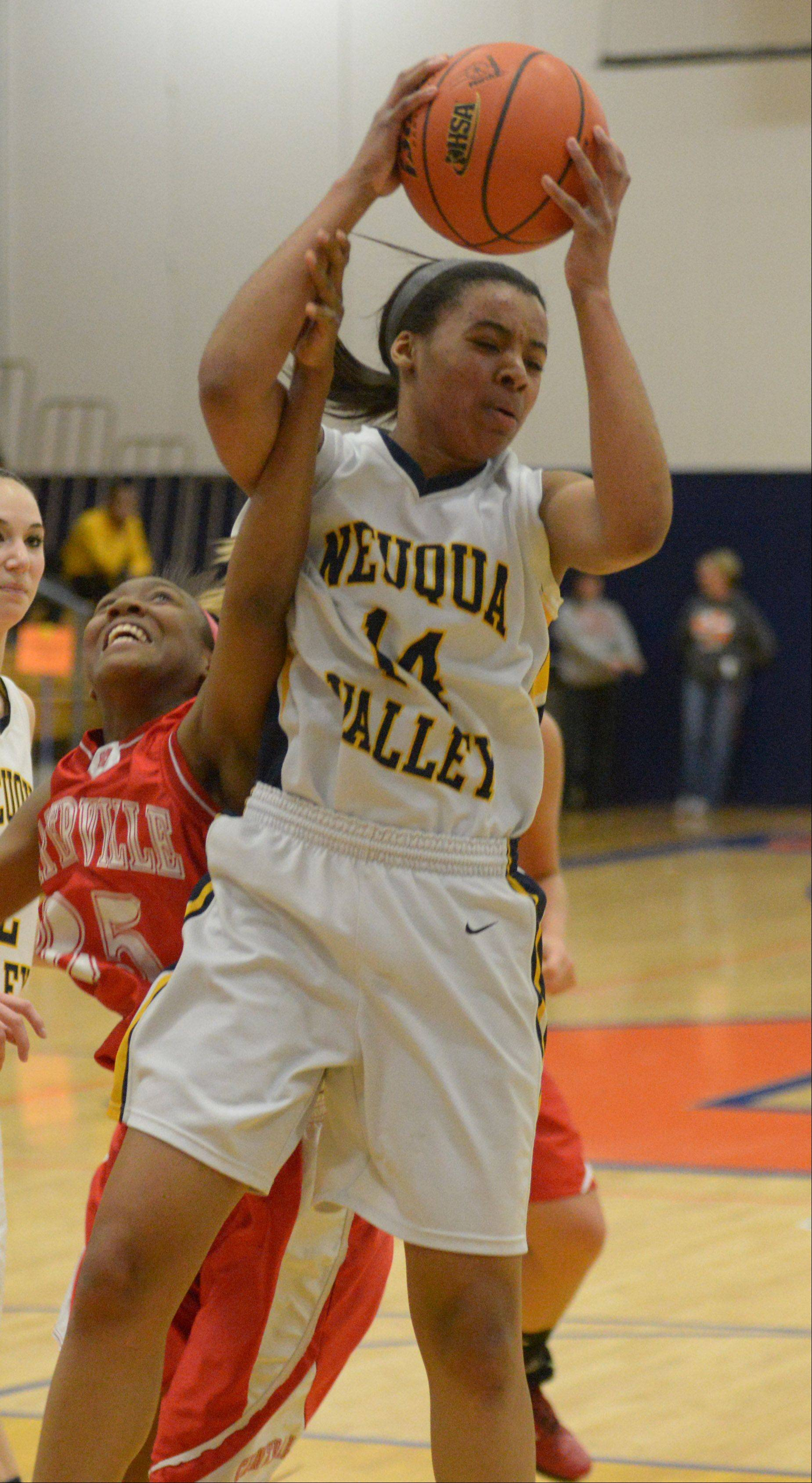 Cierra Stanciel of Naperville Central,left, and Najee Smith of Neuqua Valley go for a rebound .