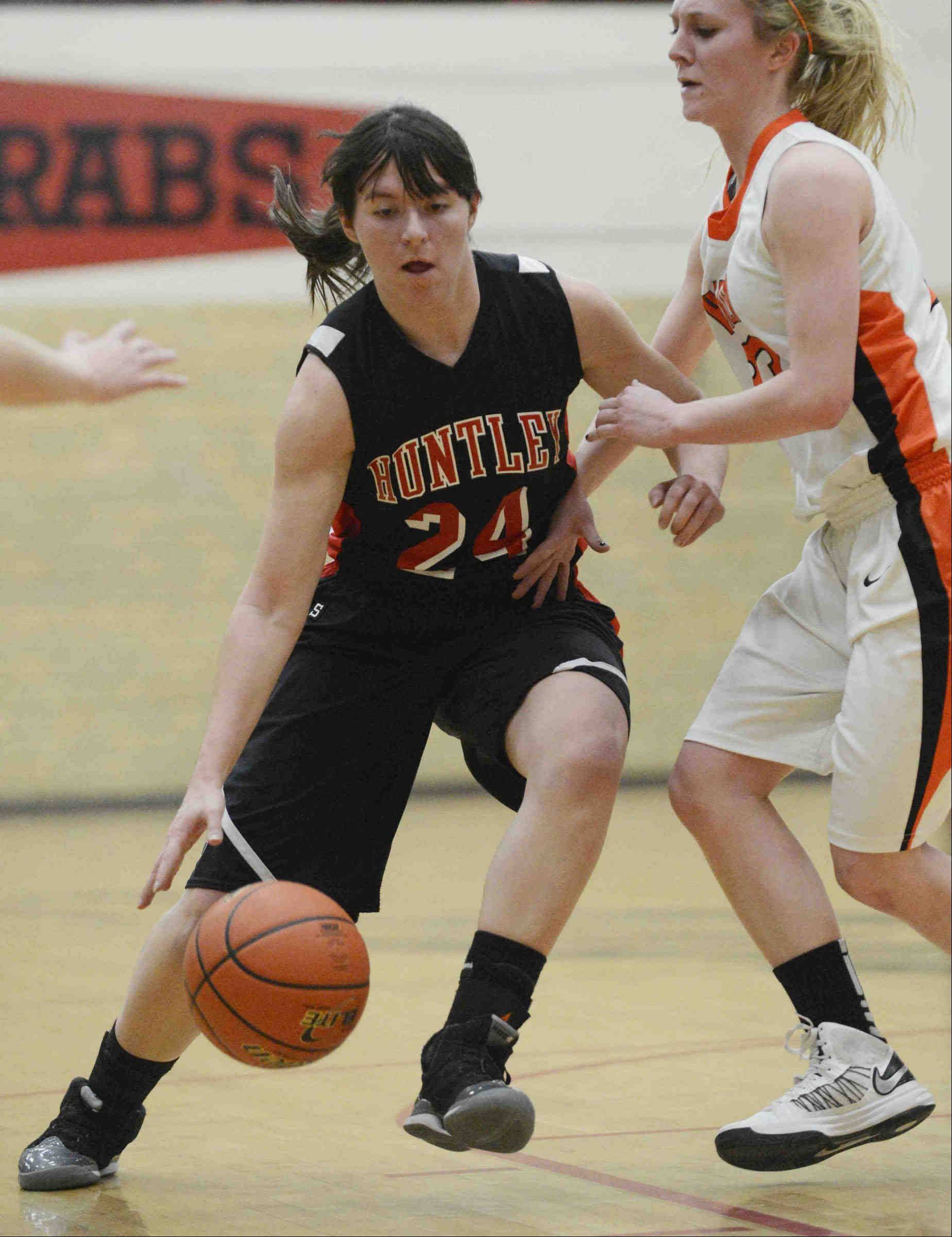 Huntley's Bethany Zornow (24) works against Harlem Tuesday night during the Class 4A Rockford East sectional.