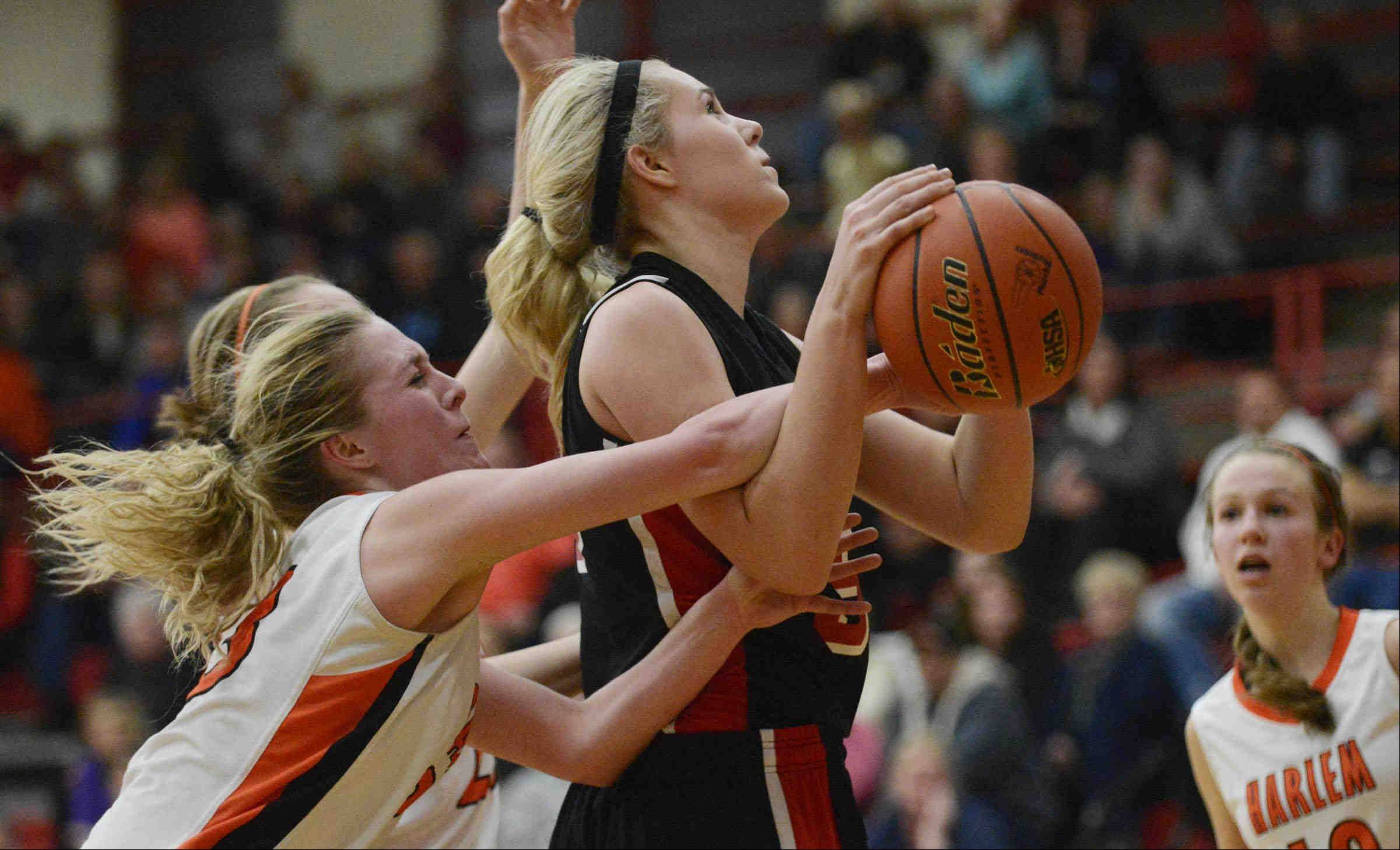 Huntley's Ali Andrews is fouled by Harlem's Serina Cortinez.
