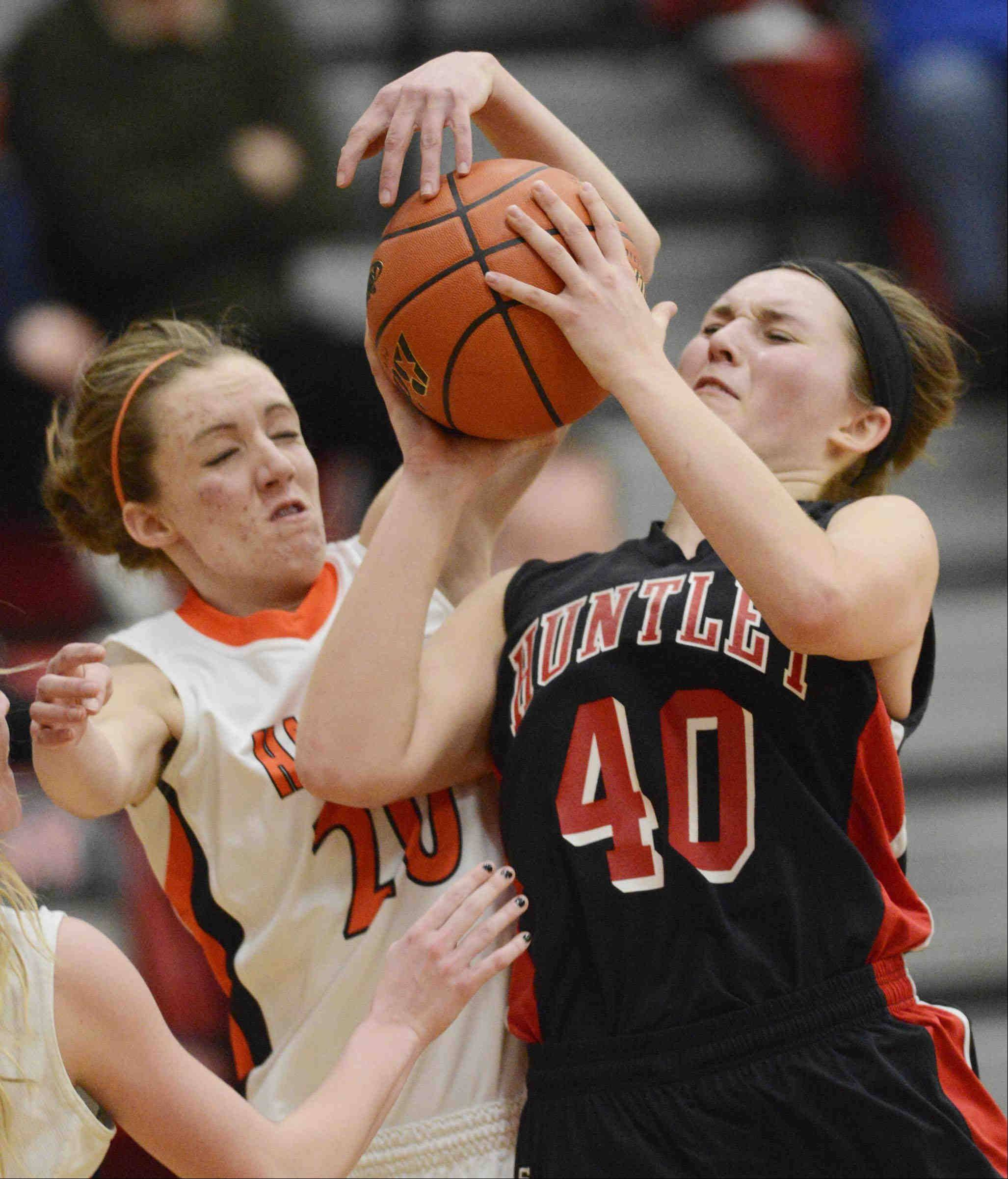Huntley's Sam Andrews is fouded by Harlem's Theresa Heitz.