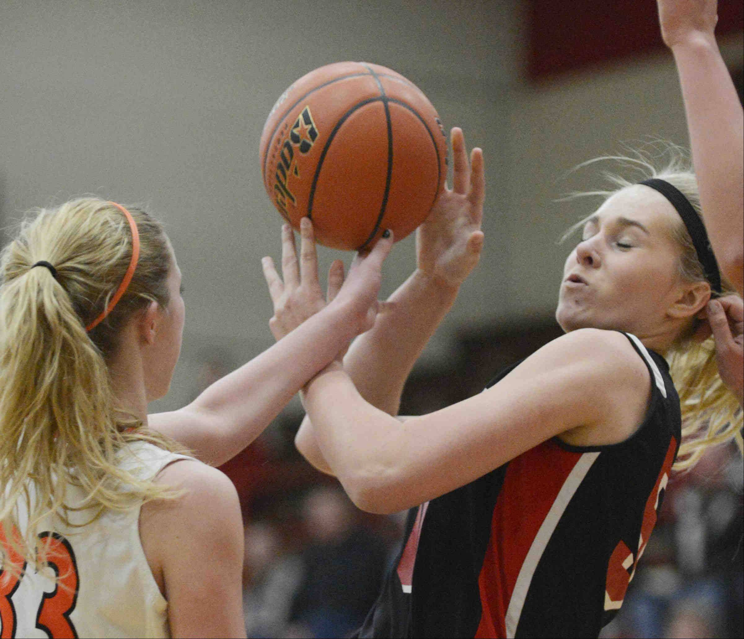 Huntley's Ali Andrews is filed by Harlem's Miranda Paddock.