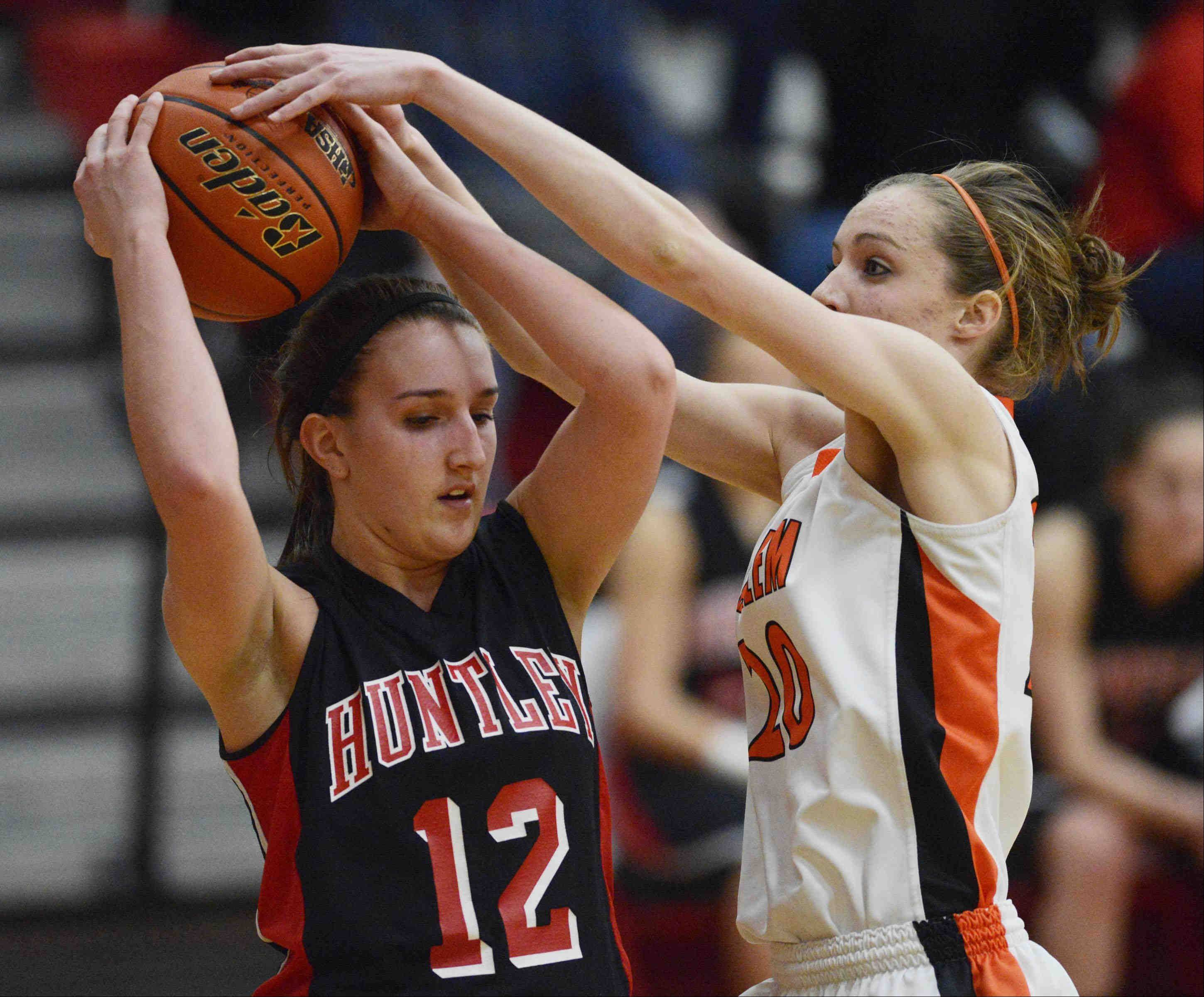Harlem's Theresa Heitz tries to get to the ball by from Huntley's Haley Ream.