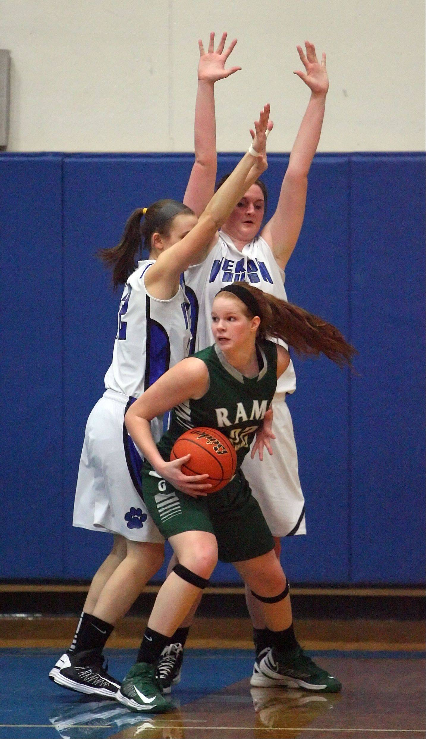 Vernon Hills' Alina Lehocky, left, and Meri Bennett-Swanson defend against Grayslake Central's Morgan Dahlstrom.