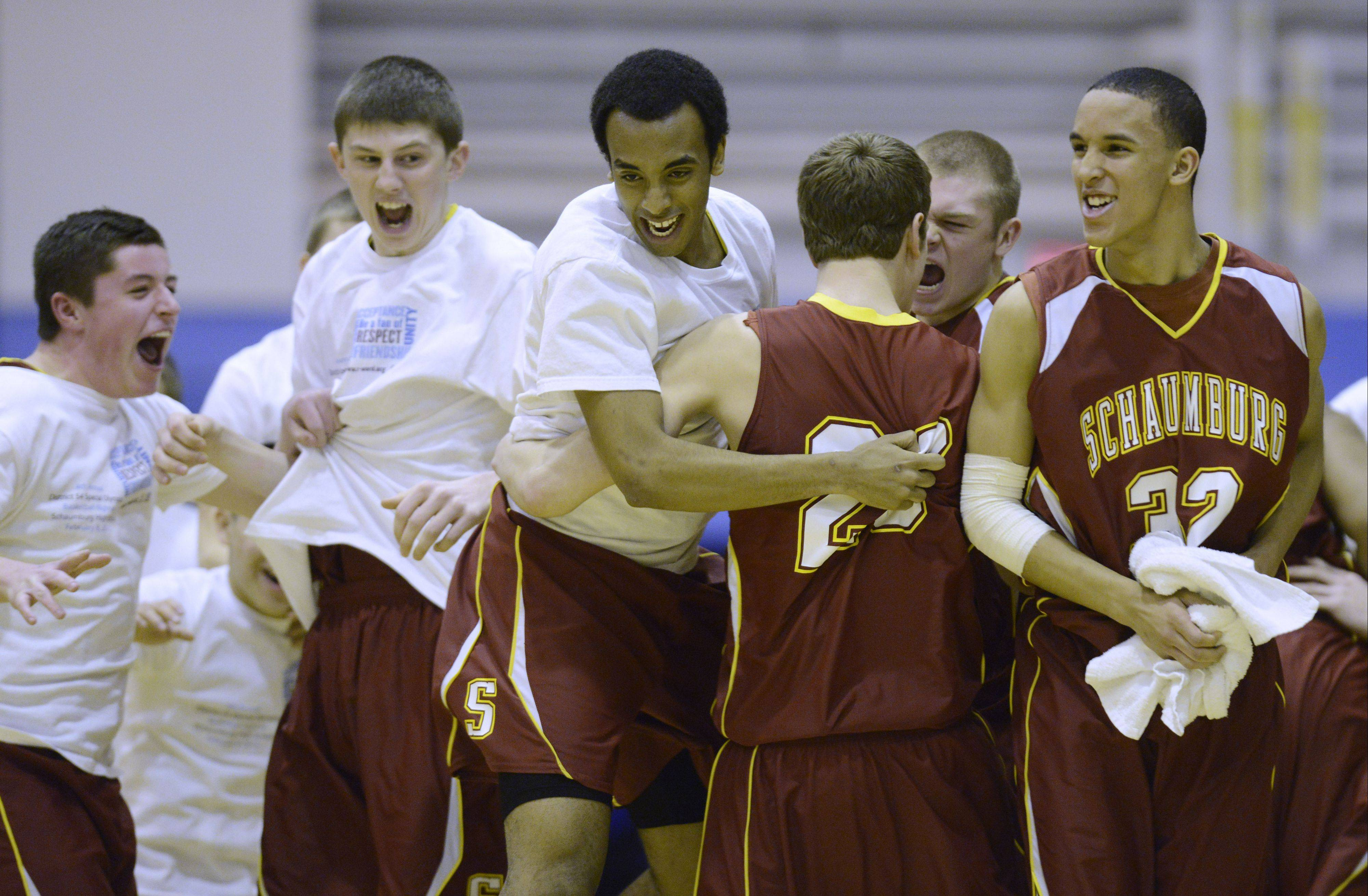 Schaumburg players celebrate their victory over Prospect in the Mid-Suburban League championship game at Prospect on Wednesday.