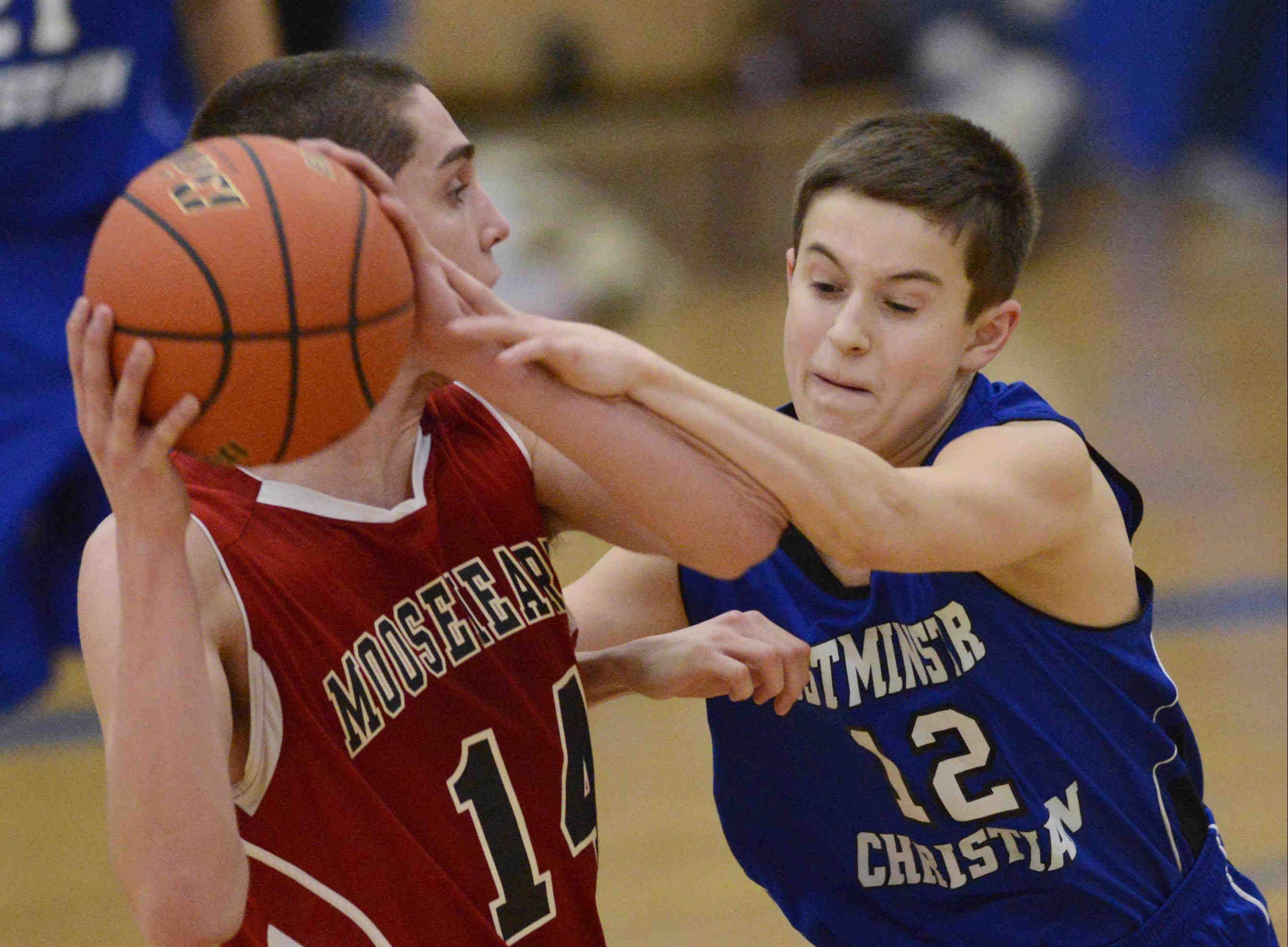 Westminster Christian's Dillon Rejman commits a reaching foul against Mooseheart's Peter Kurowski Wednesday in Elgin.