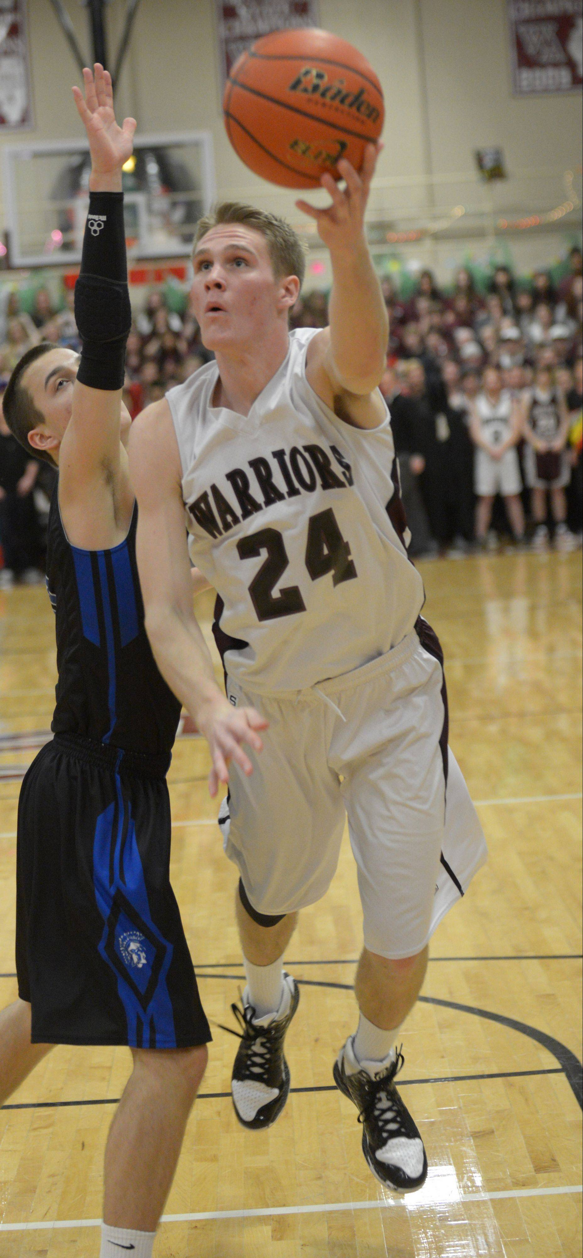 Wheaton Academy's Gordon Behr puts up a shot against St. Francis Wednesday in West Chicago.