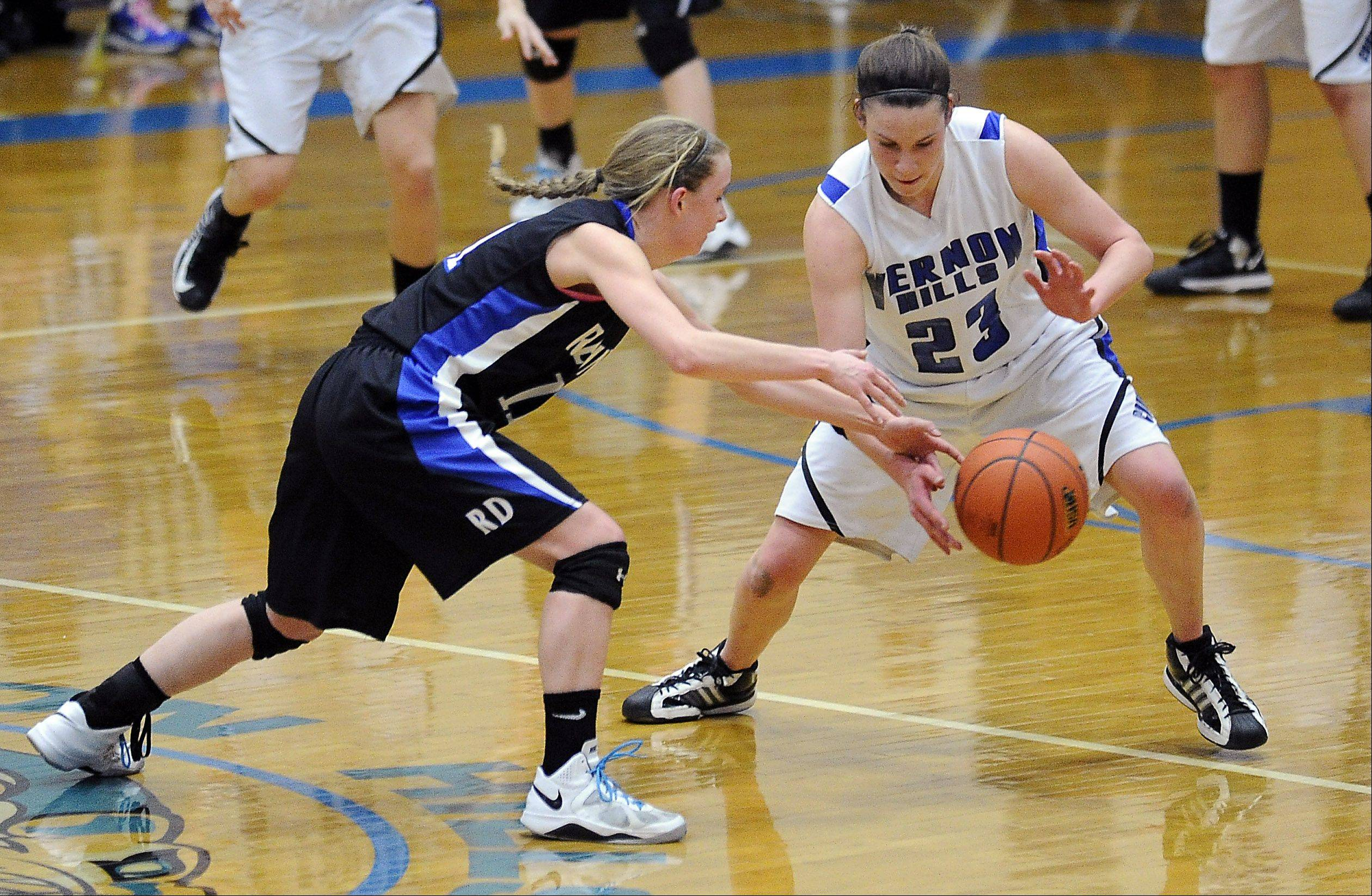 Mark Welsh/mwelsh@dailyherald.comVernon Hills' Brie Bahlmann steals the ball away from Regina Dominican's Lindsey Welch in Class3A sectional final play Thursday at Vernon Hills.