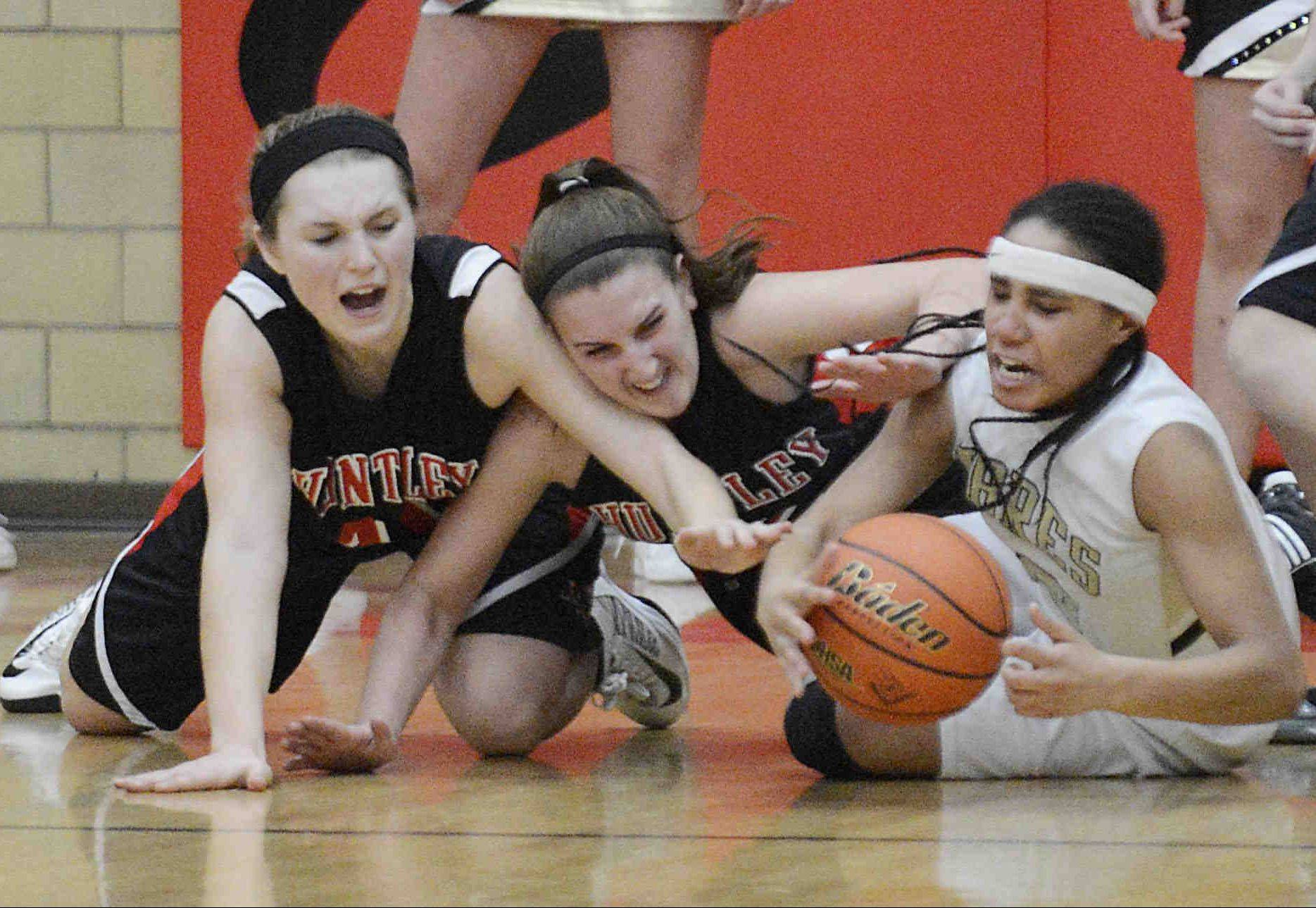 Huntley's Sam Andrews, left, and Haley Ream pressure Streamwood's Deja Moore in the closing seconds of the Class 4A Rockford East sectional championship Thursday.