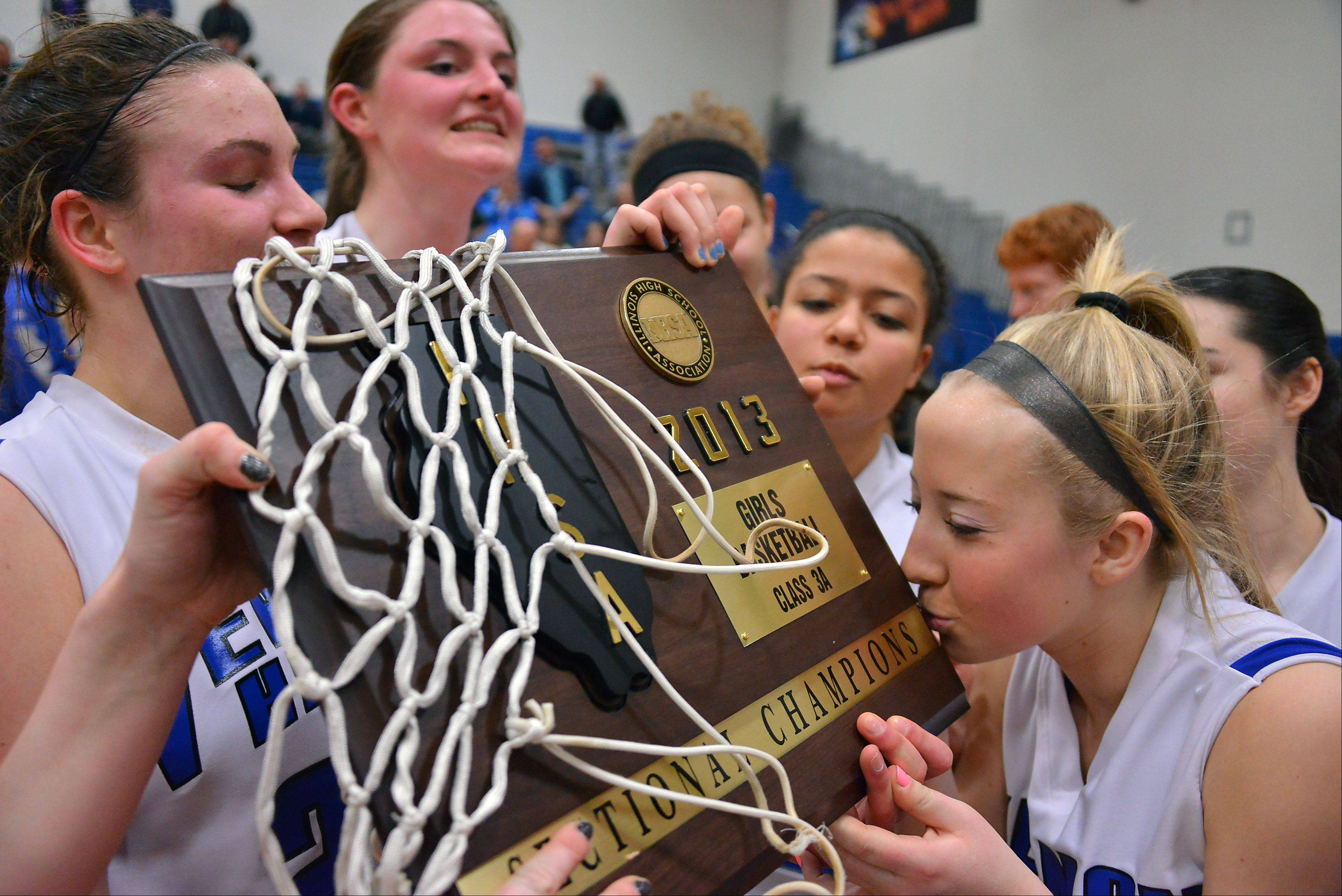 Vernon Hills' Haley Lieberman kisses the sectional champions plaque.
