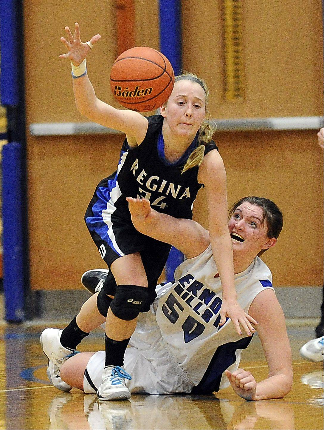 Vernon Hills' Meri Bennett-Swanson battles for a loose ball with Regina Dominican's Erin Gavin.