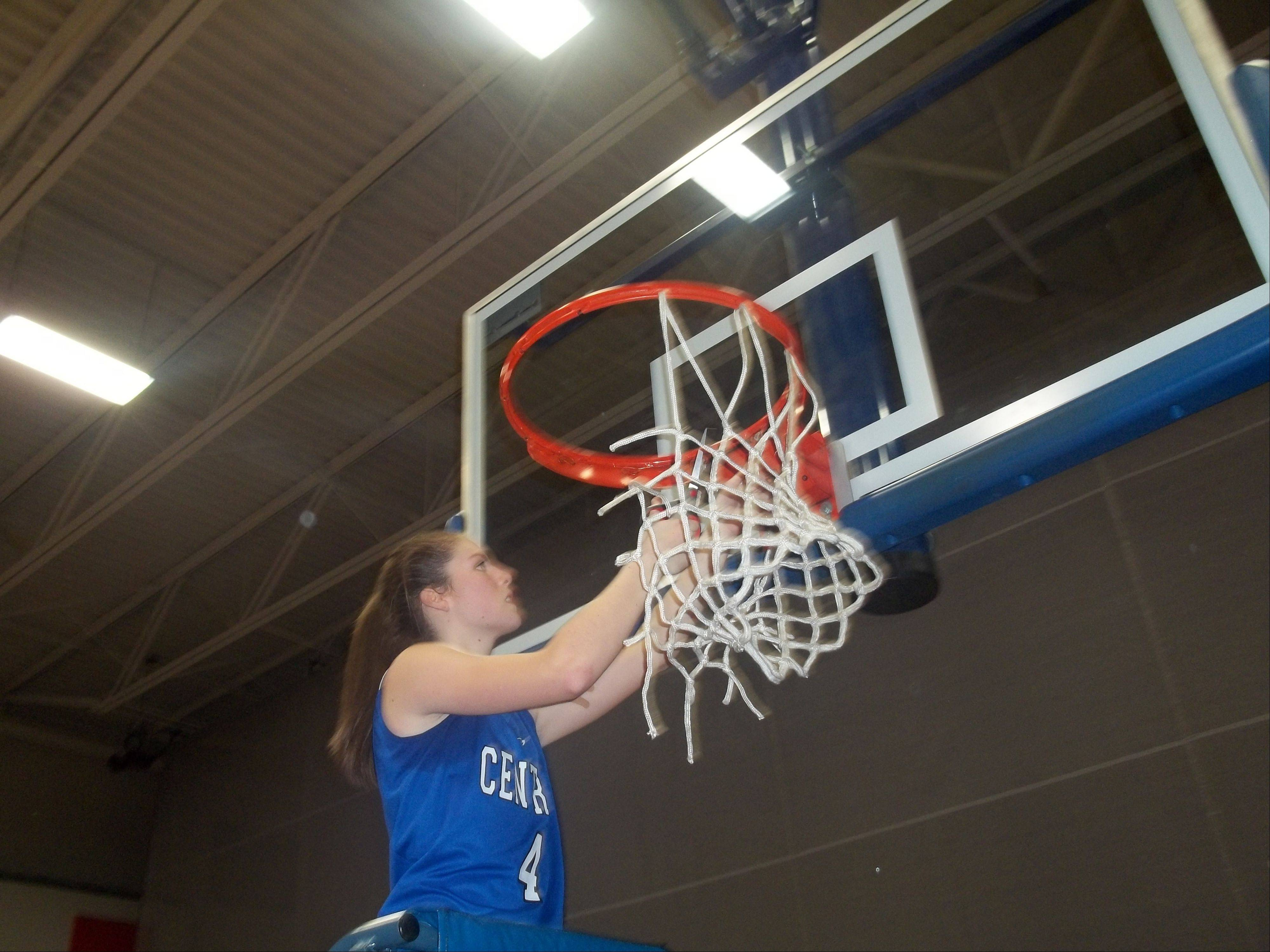 Burlington Central freshman Kayla Ross cuts a piece of the net Thursday after the Rockets' 49-26 win over Sterling in the Class 3A Genoa-Kingston sectional championship game.
