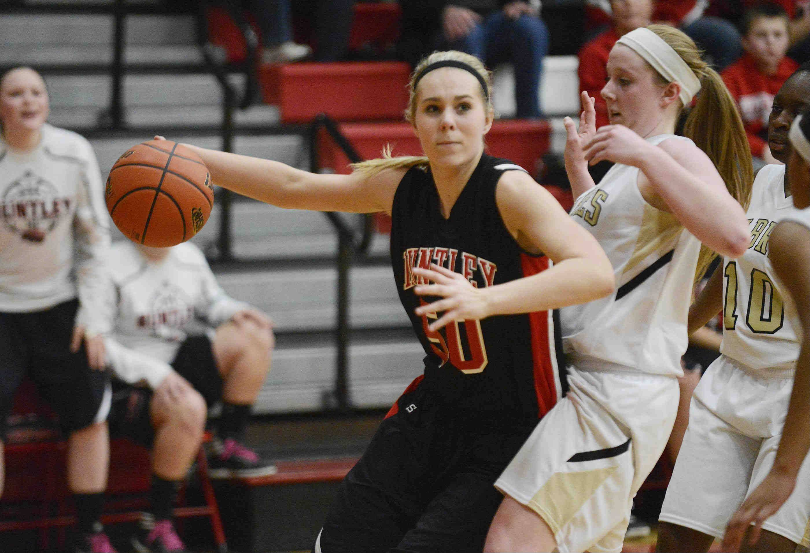 Huntley's Ali Andrews drives around Streamwood's Hannah McGlone late in the fourth quarter.