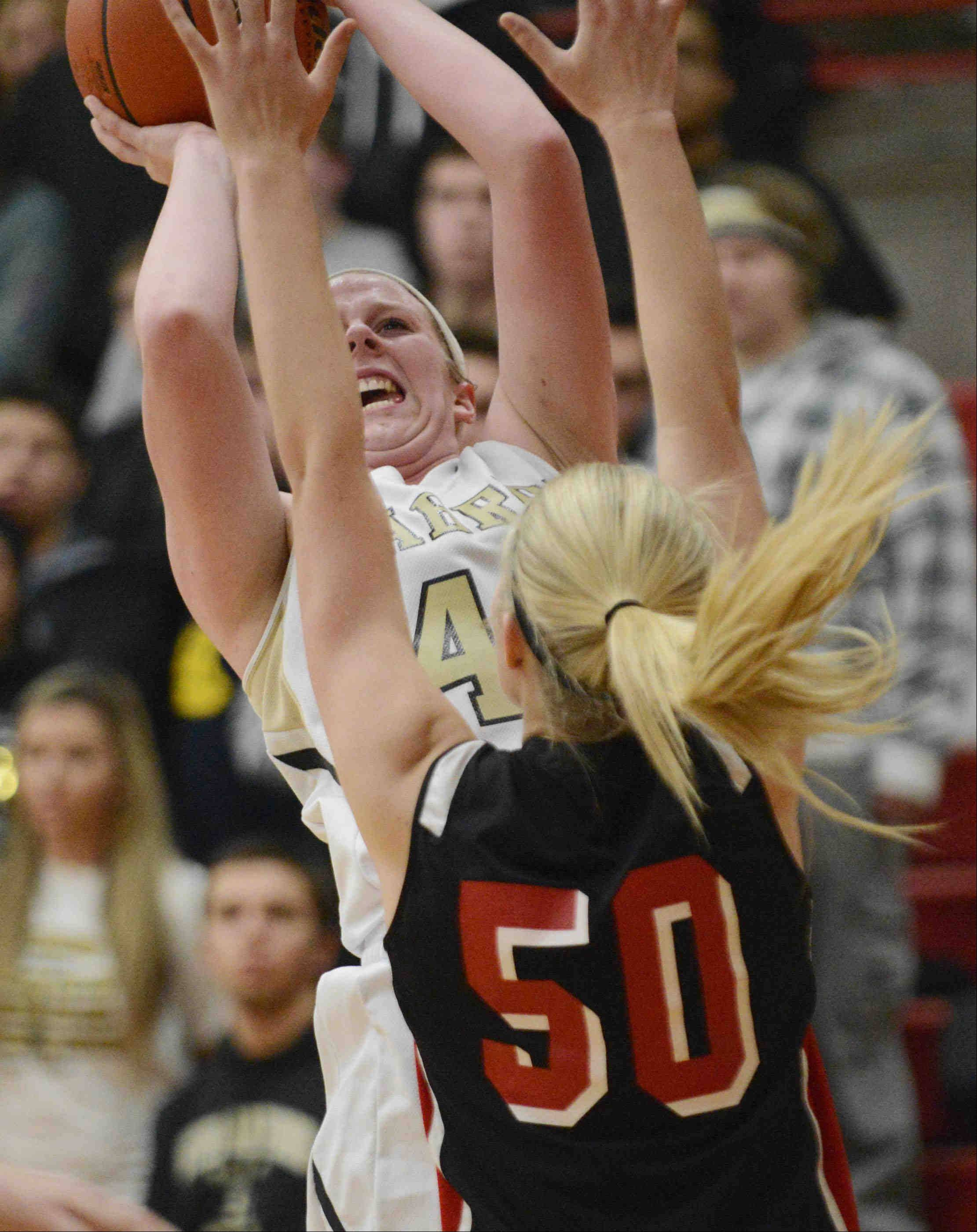 Streamwood's Hannah McGlone gets a shot over Huntley's Ali Andrews.