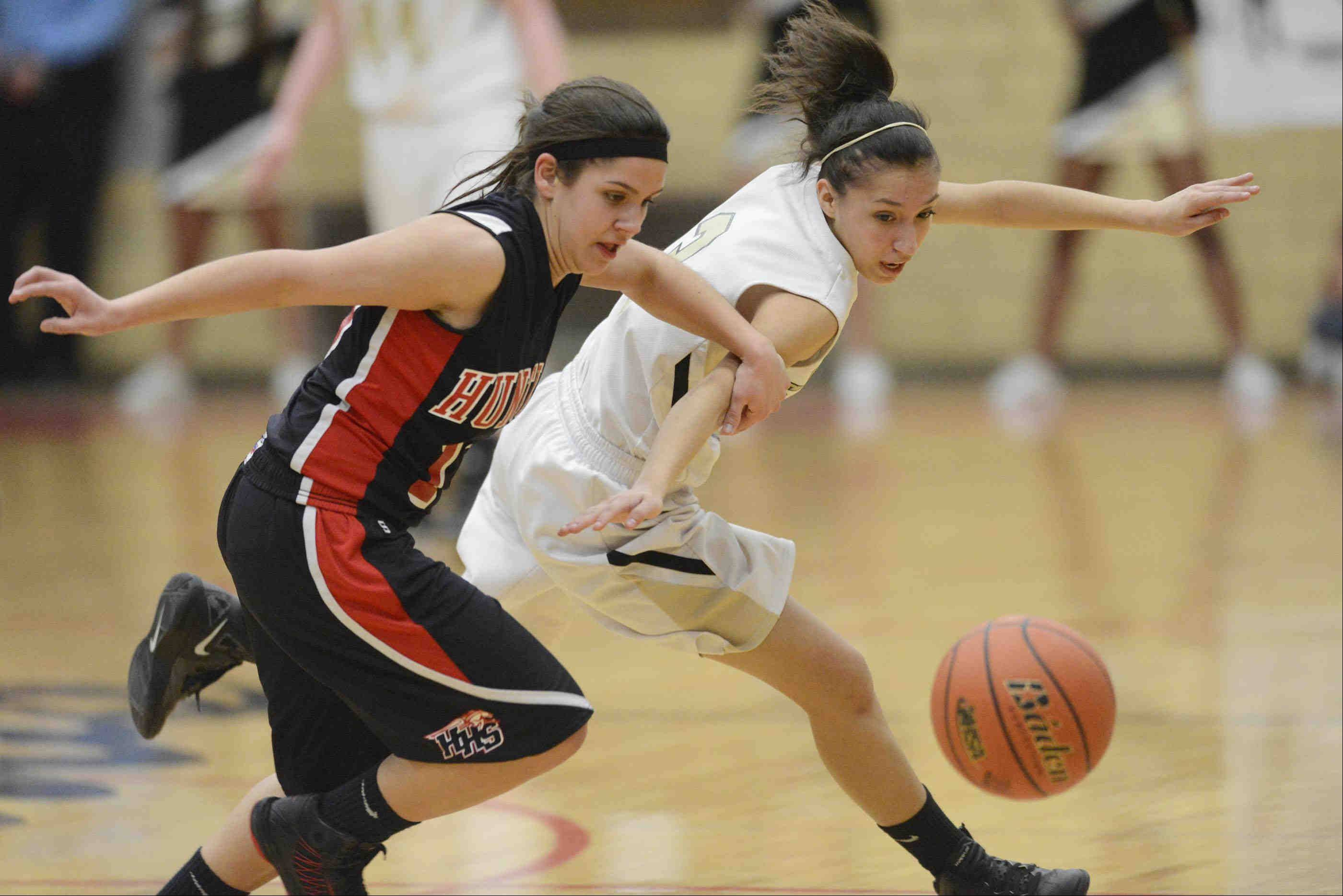 Streamwood's Kimberly Jimenez and Huntley's Kayla Barreto scramble for the ball.