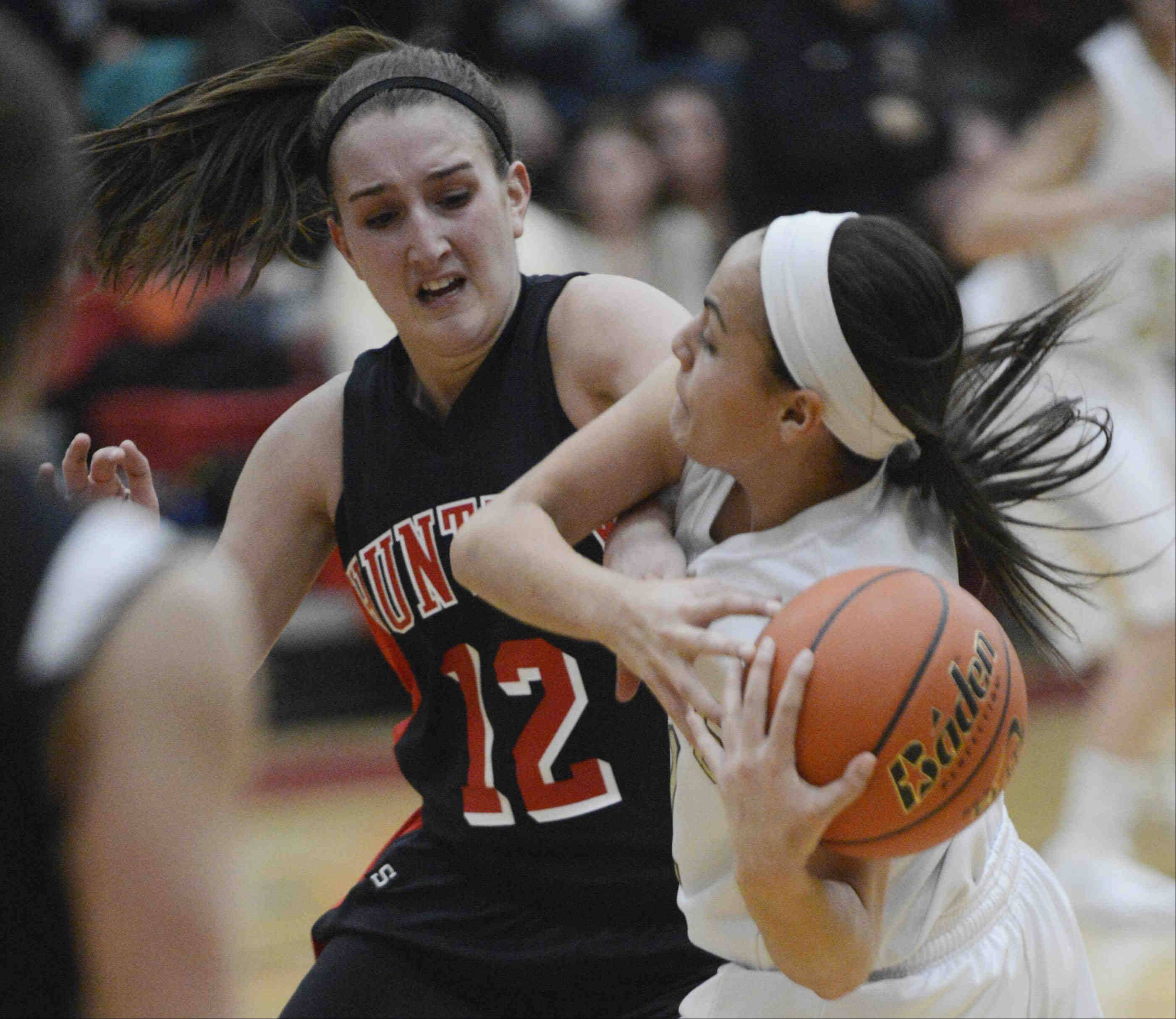 Huntley's Haley Ream forces a turnover against Streamwood's Brittany Delao late in the fourth quarter .