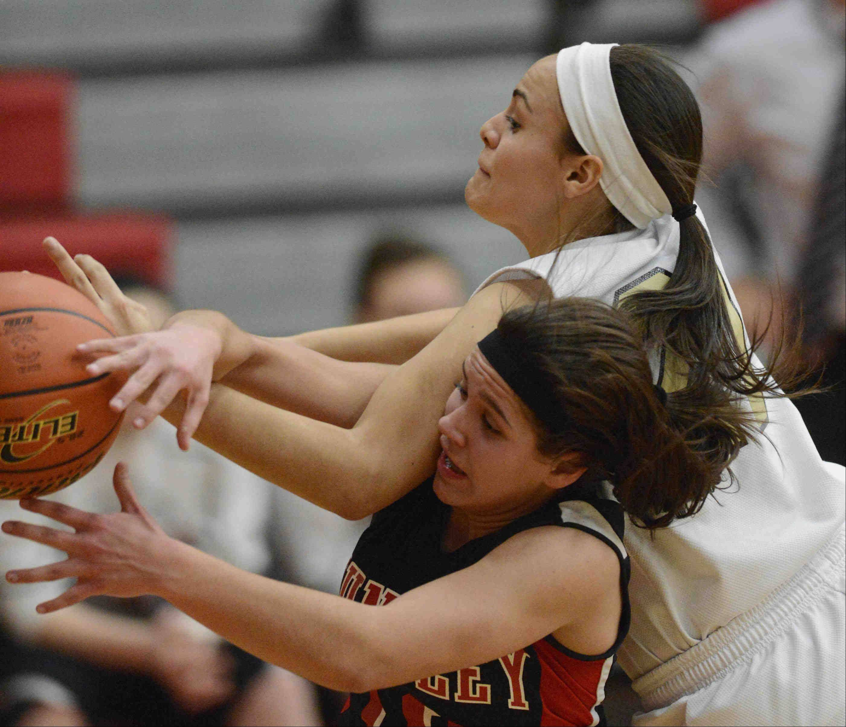 Streamwood's Brittany Delao fouls Huntley's Kayla Barreto.