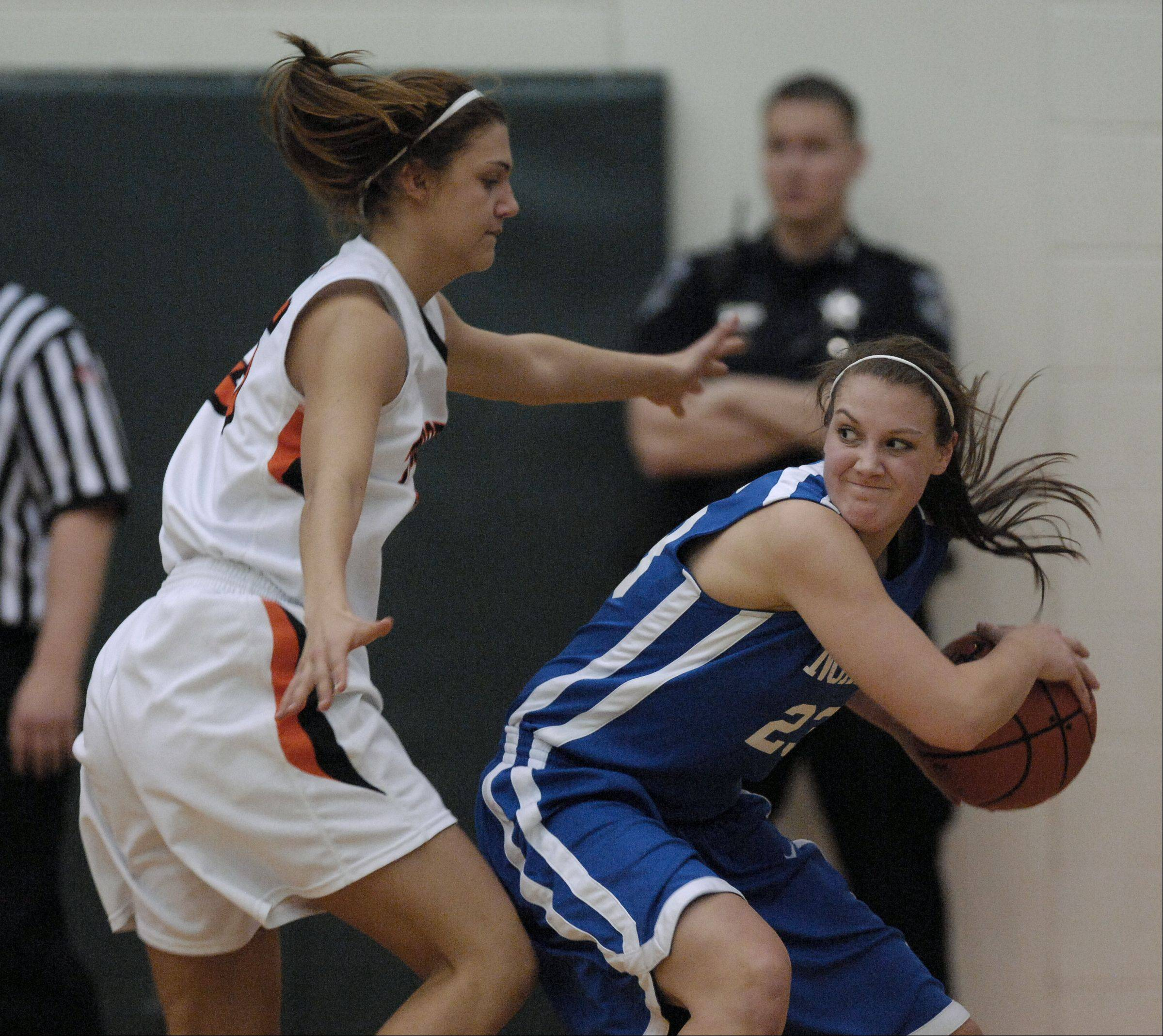 Alyssa Zappia of Wheaton Warrenville South guards Chrissy Baird of Wheaton North.
