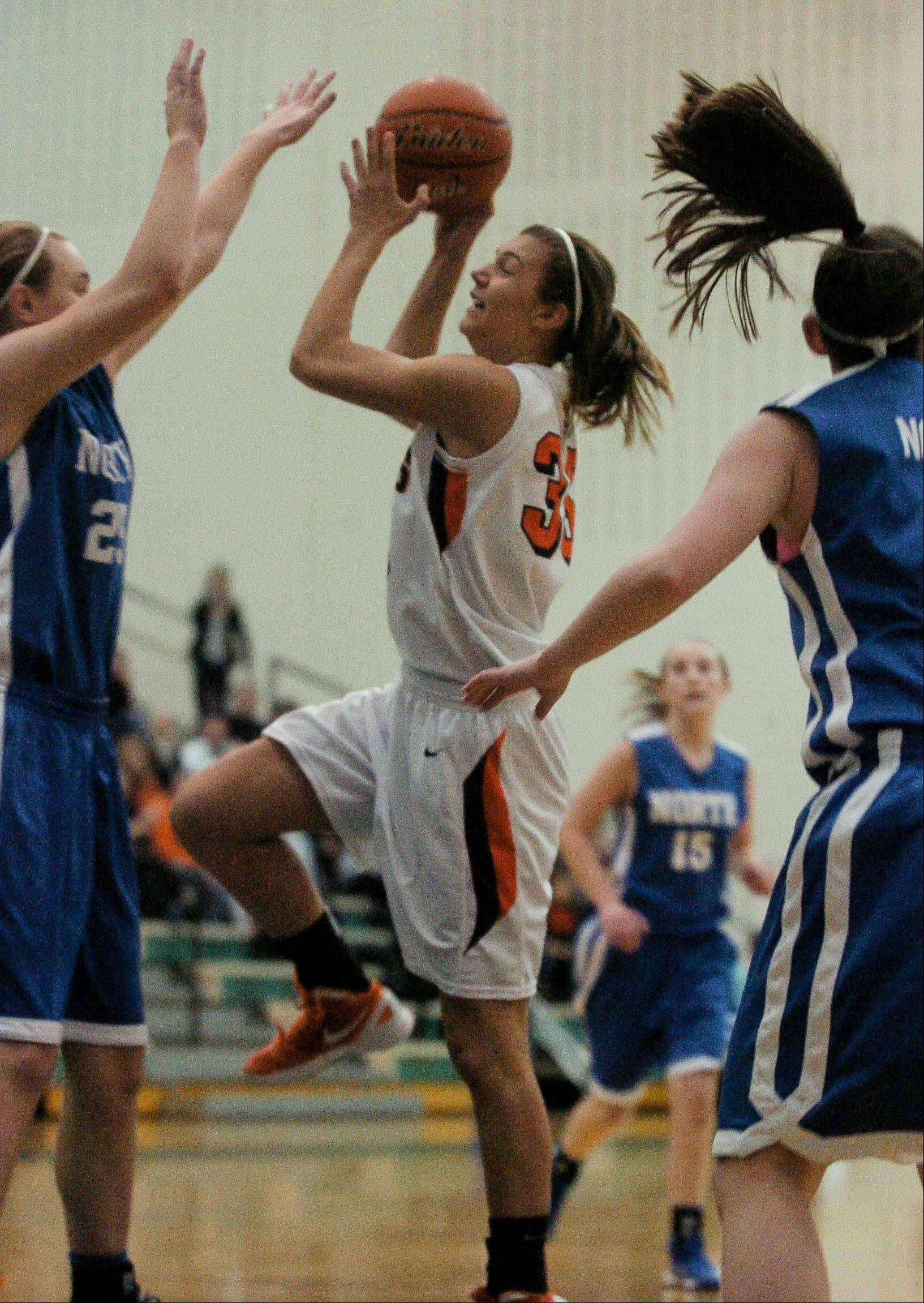 Alyssa Zappia of Wheaton Warrenville South goes up for a shot against Wheaton North.