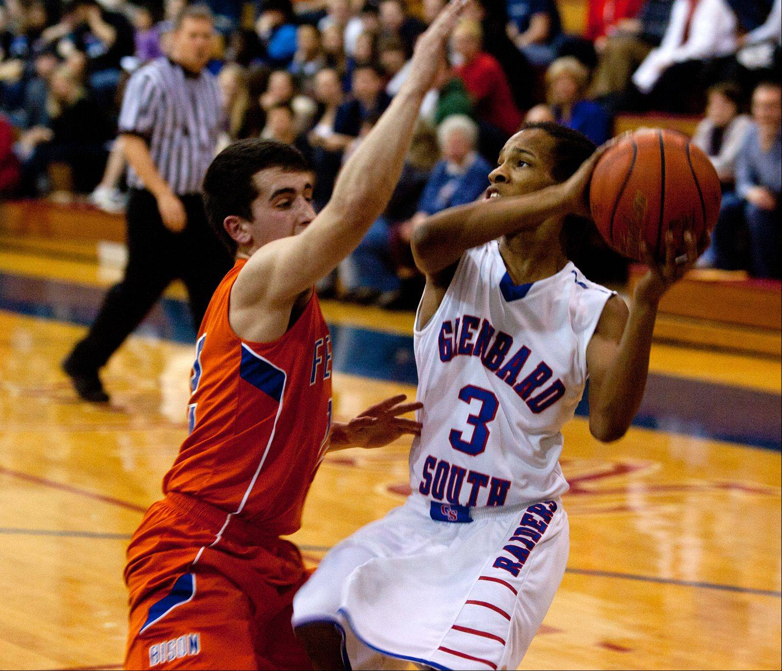 Glenbard South's Chaun Rickette (3), eyes the basket for a pair of his 16 first quarter points against Fenton.