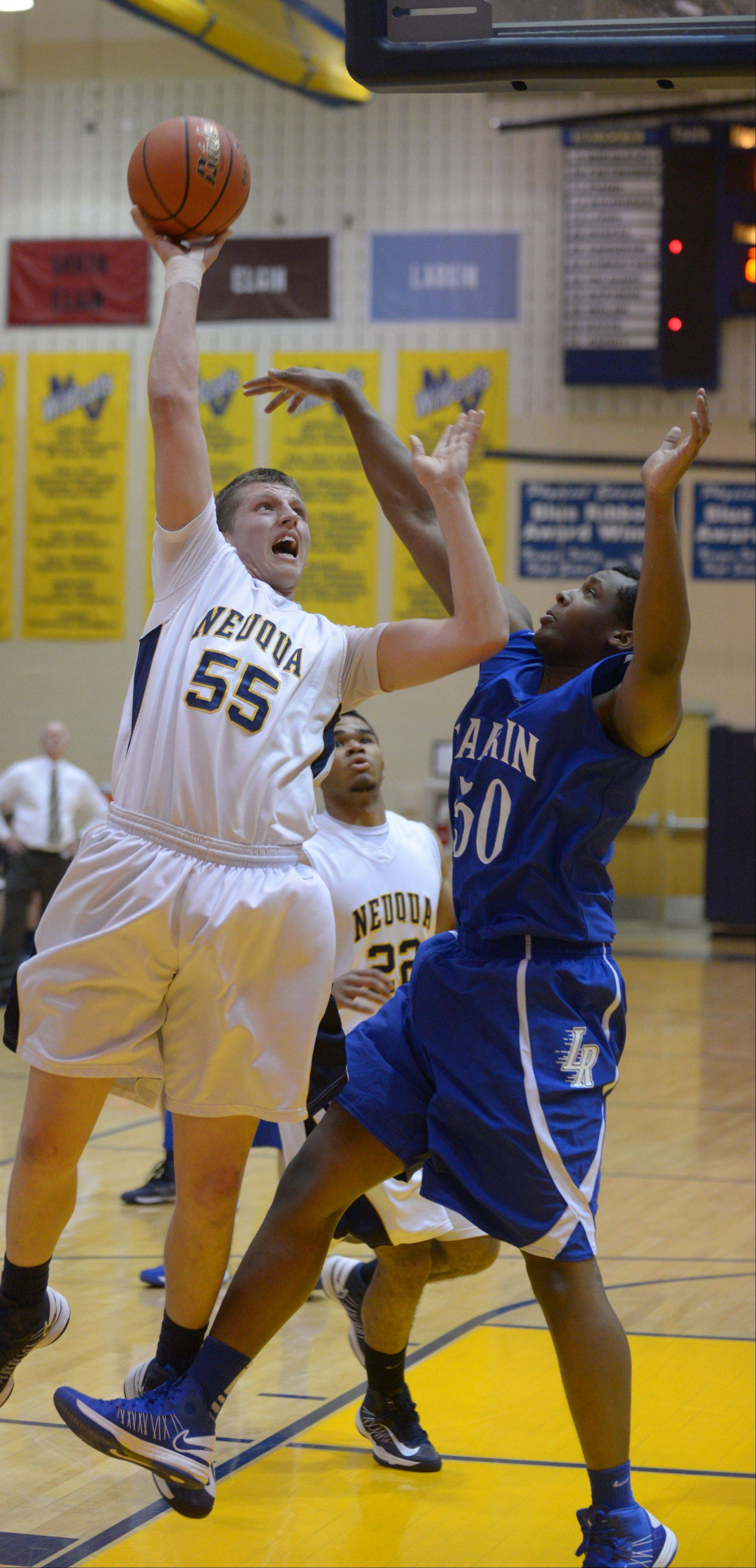 Pat Kenny,left, of Neuqua Valley takes a shot while Daniel McFadden of Larkin blocks.