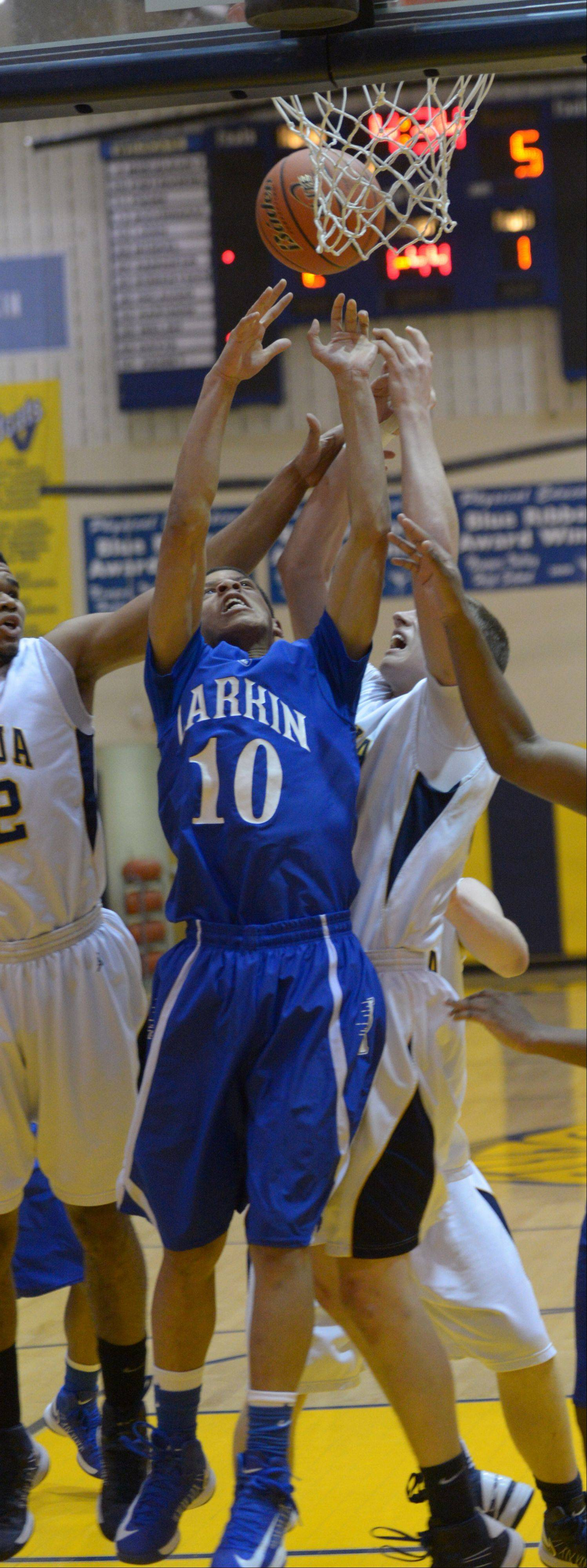 Kendale McCullum of Larkin goes up for a rebound.