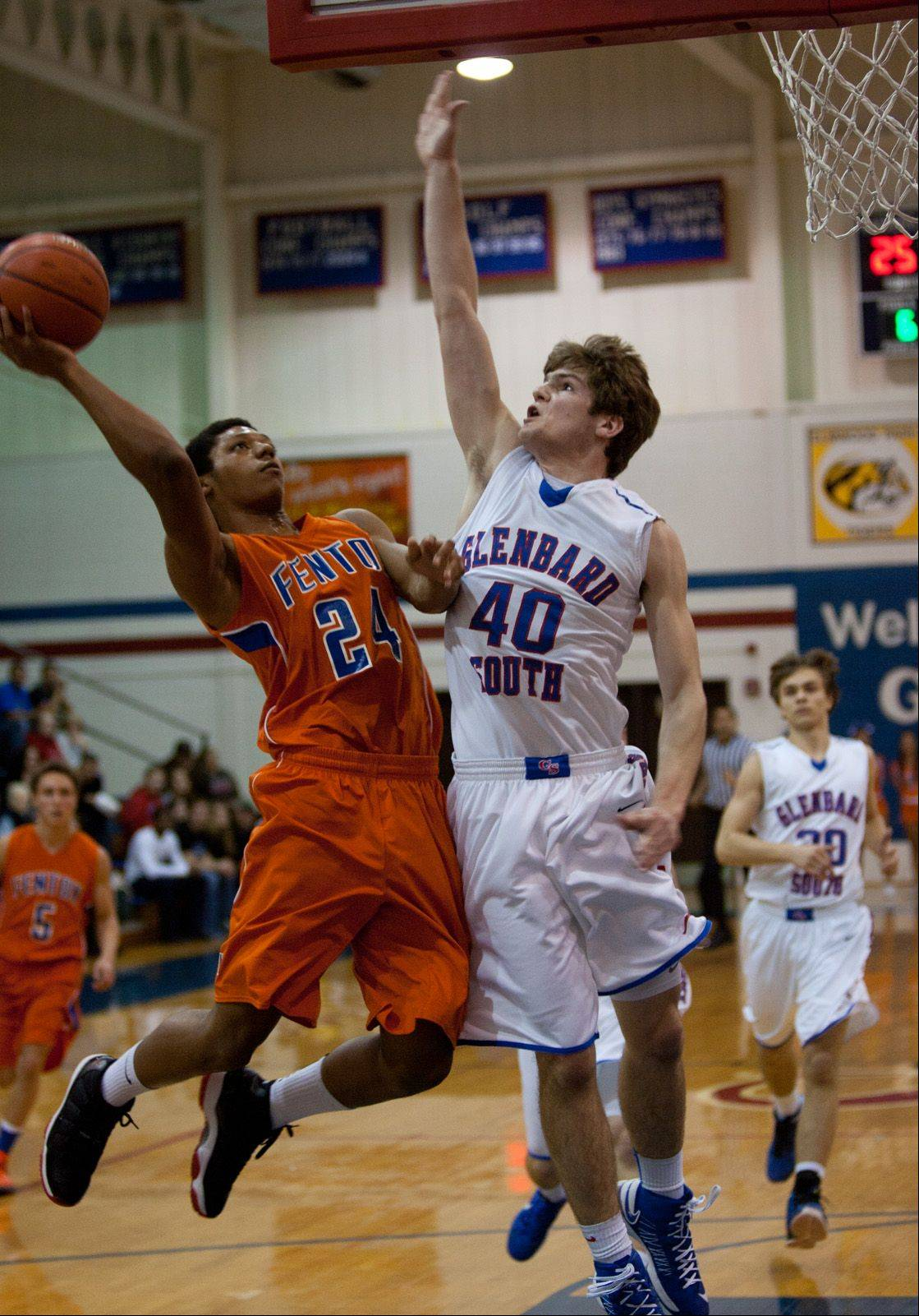 Fenton's DeMarcus Stone shoots over Glenbard South's John Marks .