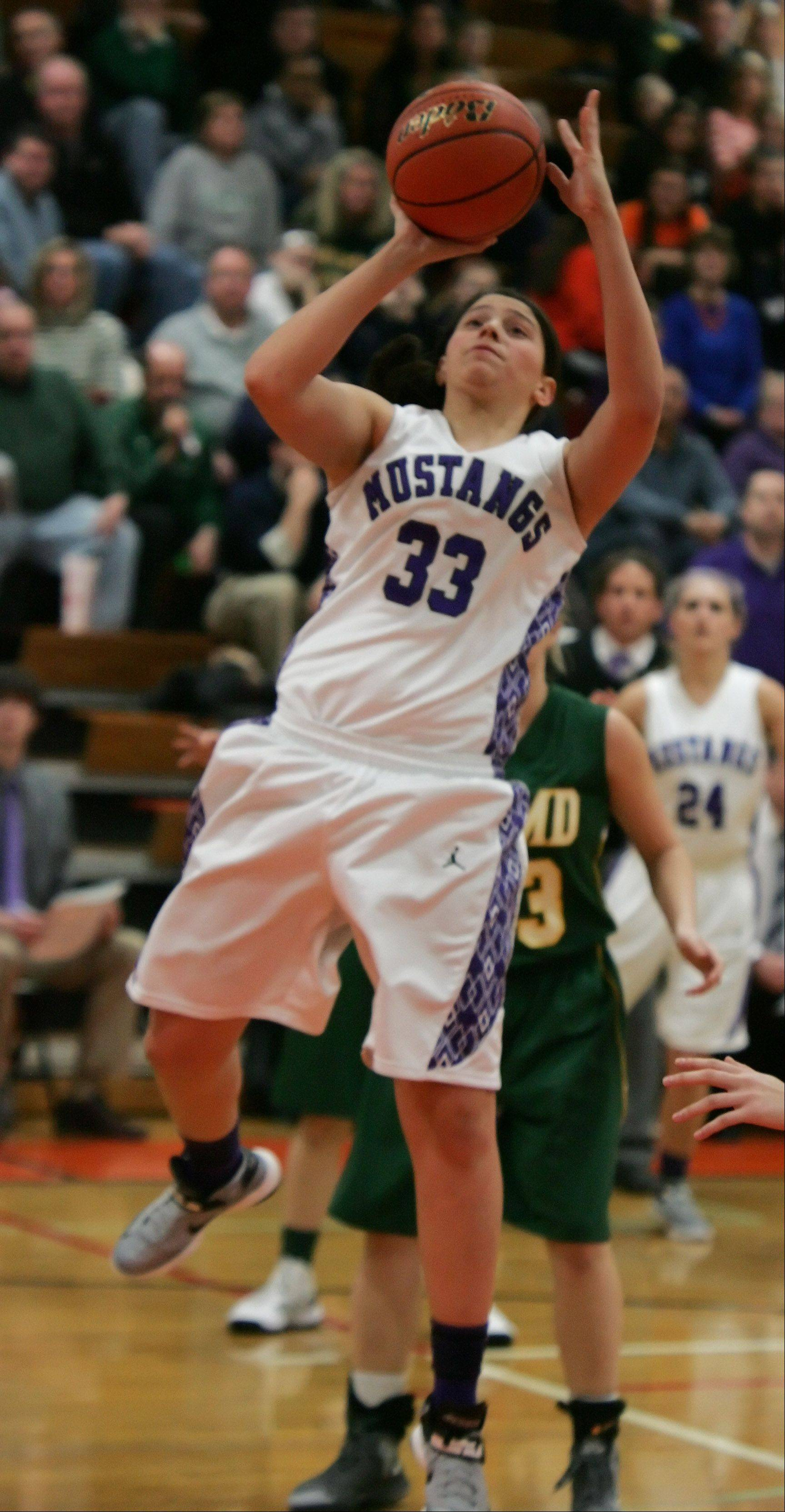 Rolling Meadows forward Ashley Montanez goes up for a layup.