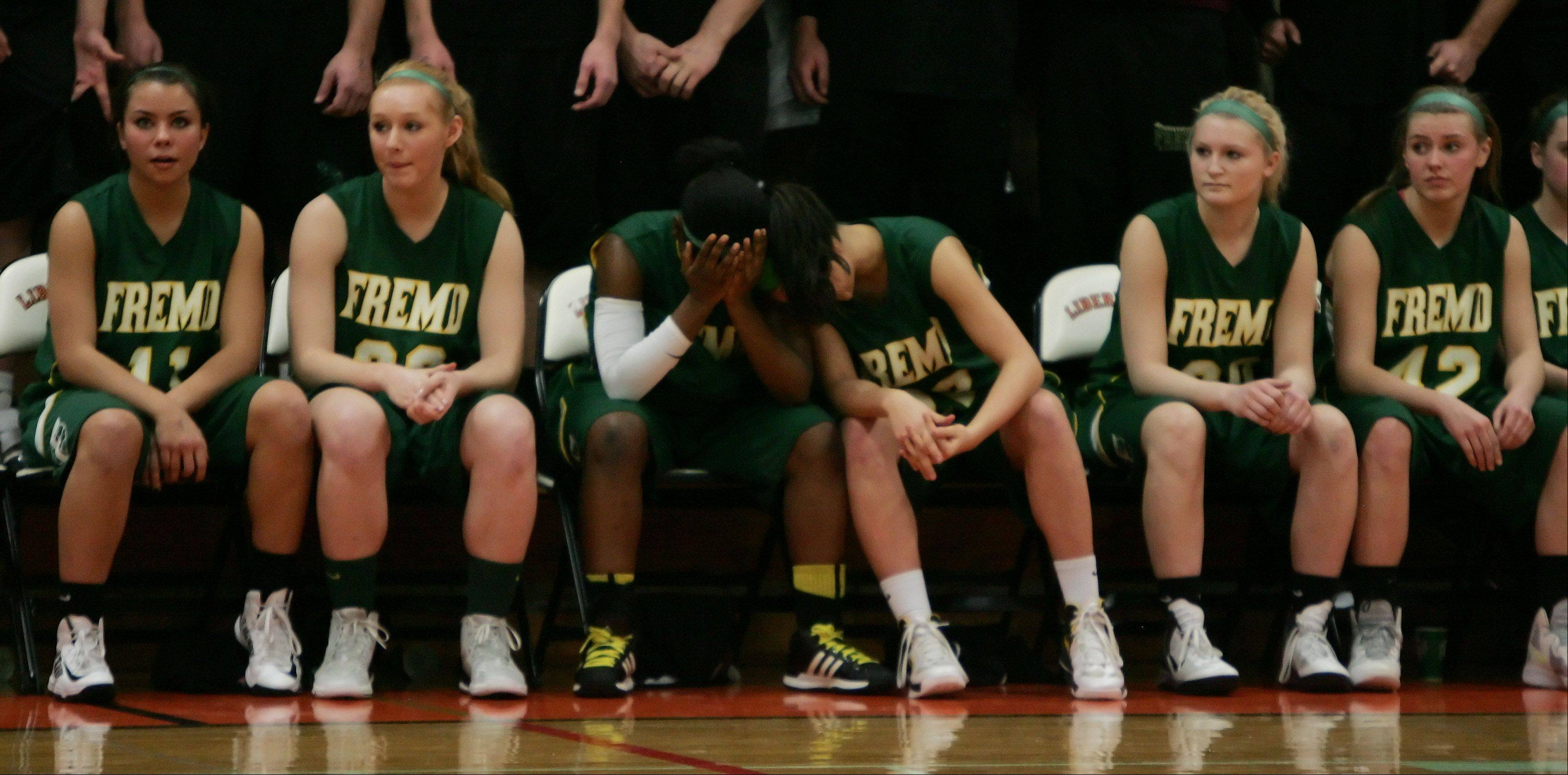 Fremd players on the bench watch as the game comes to end.
