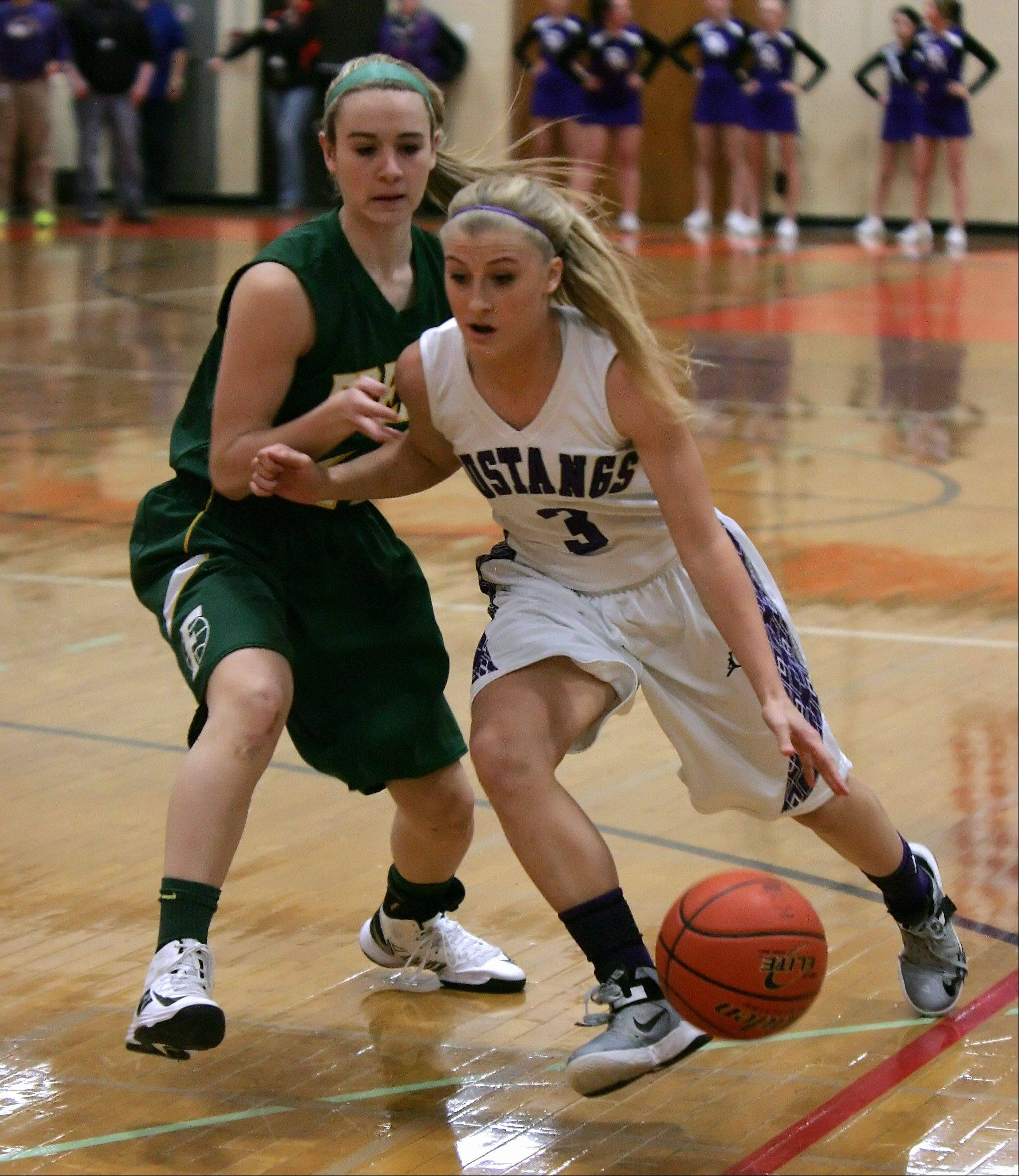 Rolling Meadows guard Jackie Kemph drives around Fremd guard Ashley McConnell.