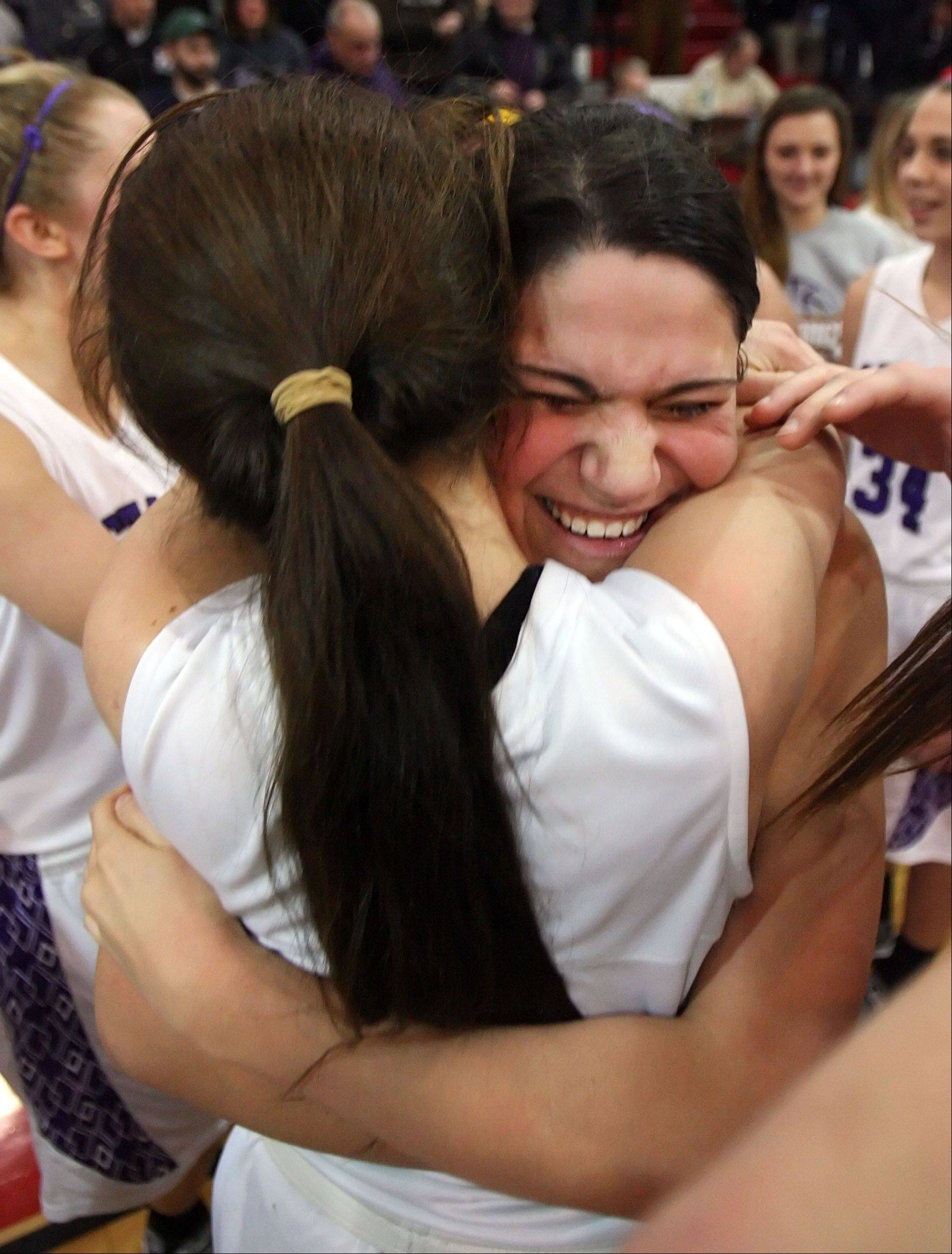 Rolling Meadows' Ashley Montanez, back, and Sami Kay hug after beating Evanston in Class 4A Niles West supersectional play Monday night in Skokie.