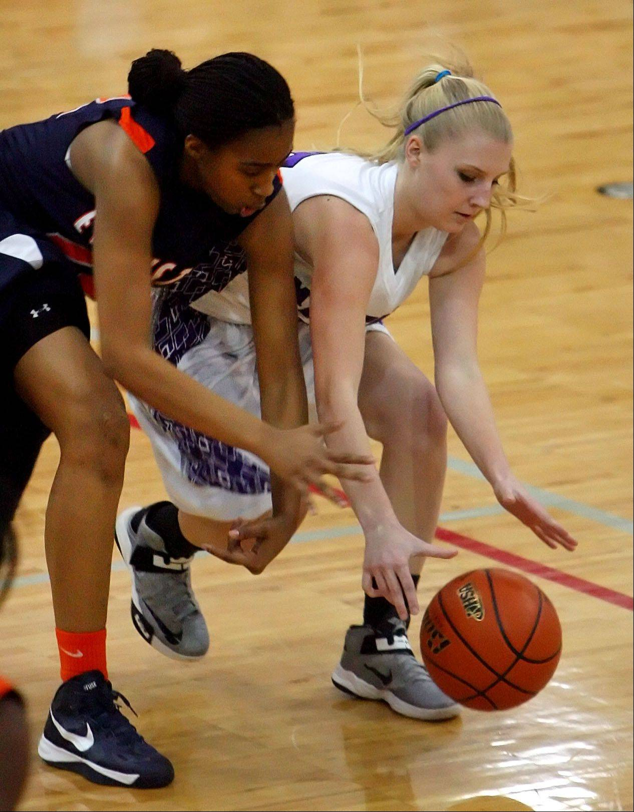 Steve Lundy/slundy@dailyherald.com Rolling Meadows' Allie Kemph, right and Evanston's Dashae Shumate battle for a loose ball in Class 4A Niles West supersectional action Monday night in Skokie.