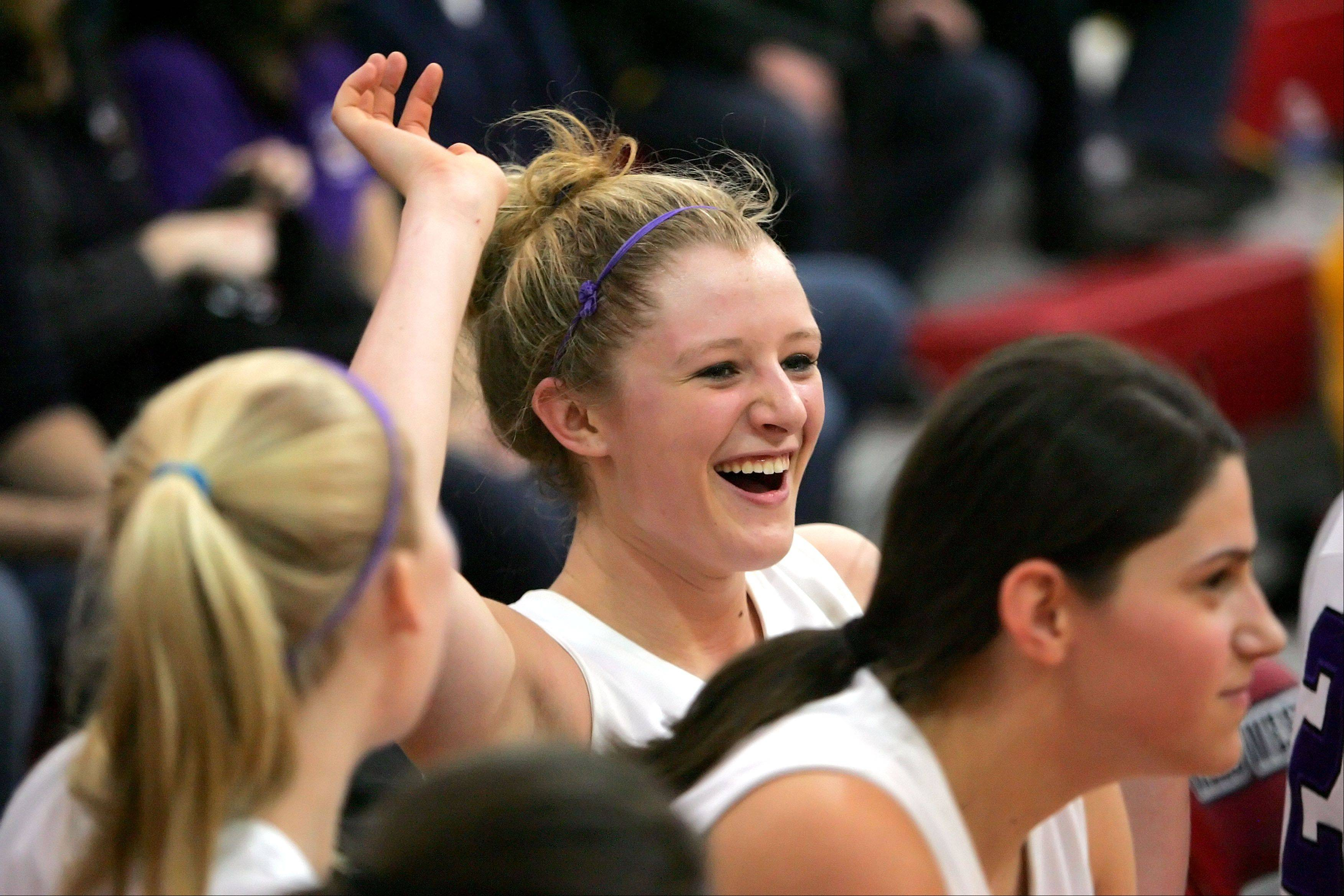 Rolling Meadows' Jenny Vliet celebrates with teammates on the bench in Class 4A Niles West supersectional play Monday night in Skokie.