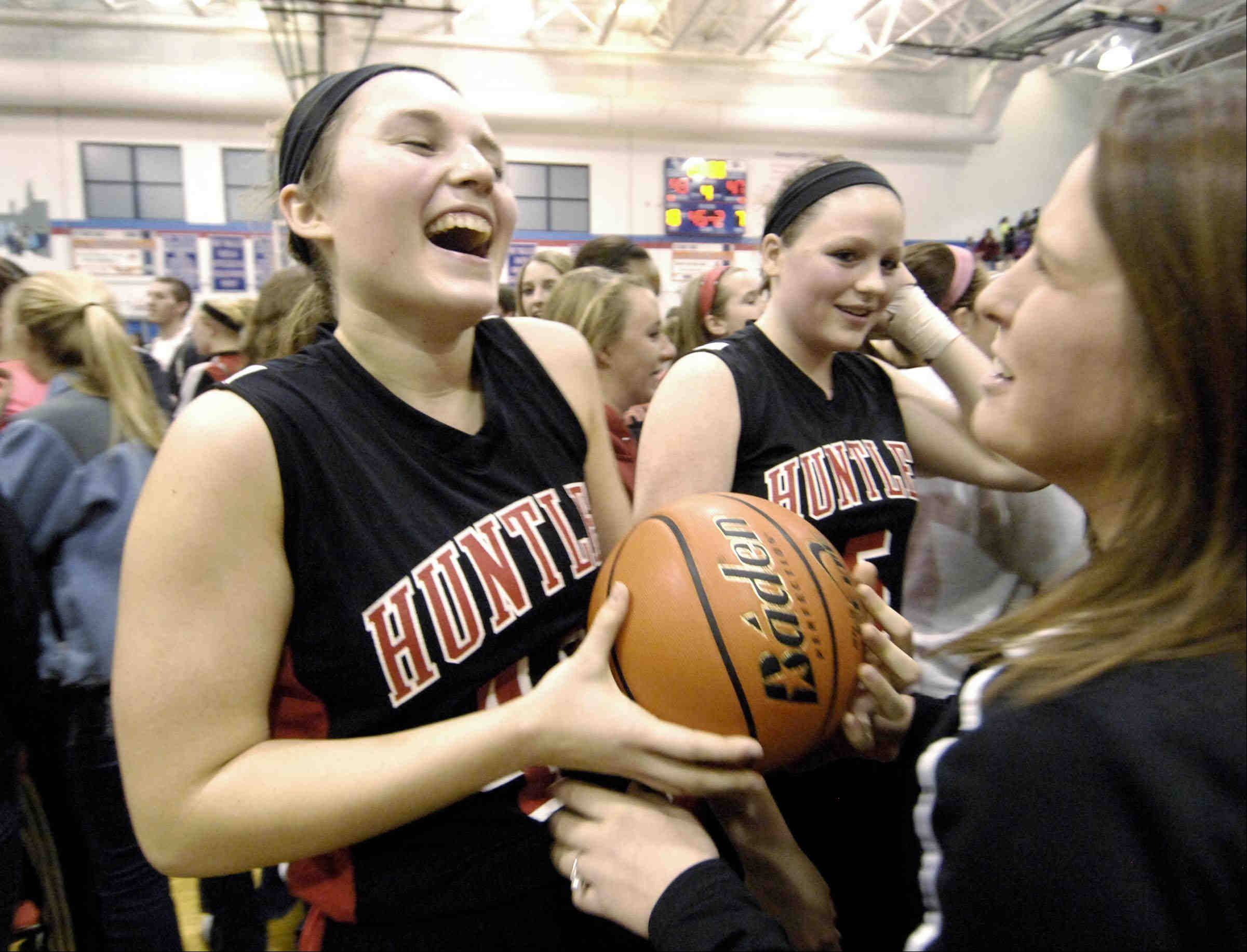 Huntley's Sam Andrews laughs with the game ball after defeating Wheaton Warrenville South Monday in the Class 4A Dundee-Crown supersectional game in Carpentersville.