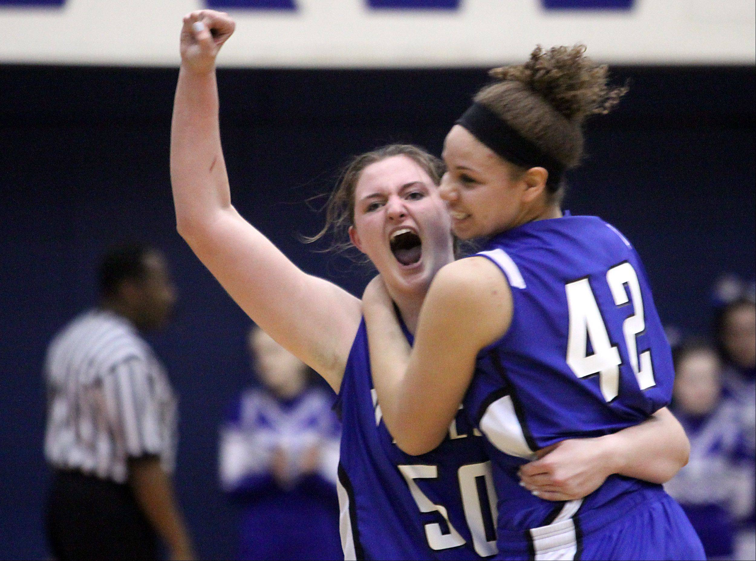 Vernon Hills players Meri Bennett-Swanson, left, and Lauren Webb celebrate their 39-31 Class 3A supersectional win over Burlington Central at Hoffman Estates High School on Monday night. The Cougars advance to the finals of the state tournament this weekend at Redbird Arena in Bloomington.