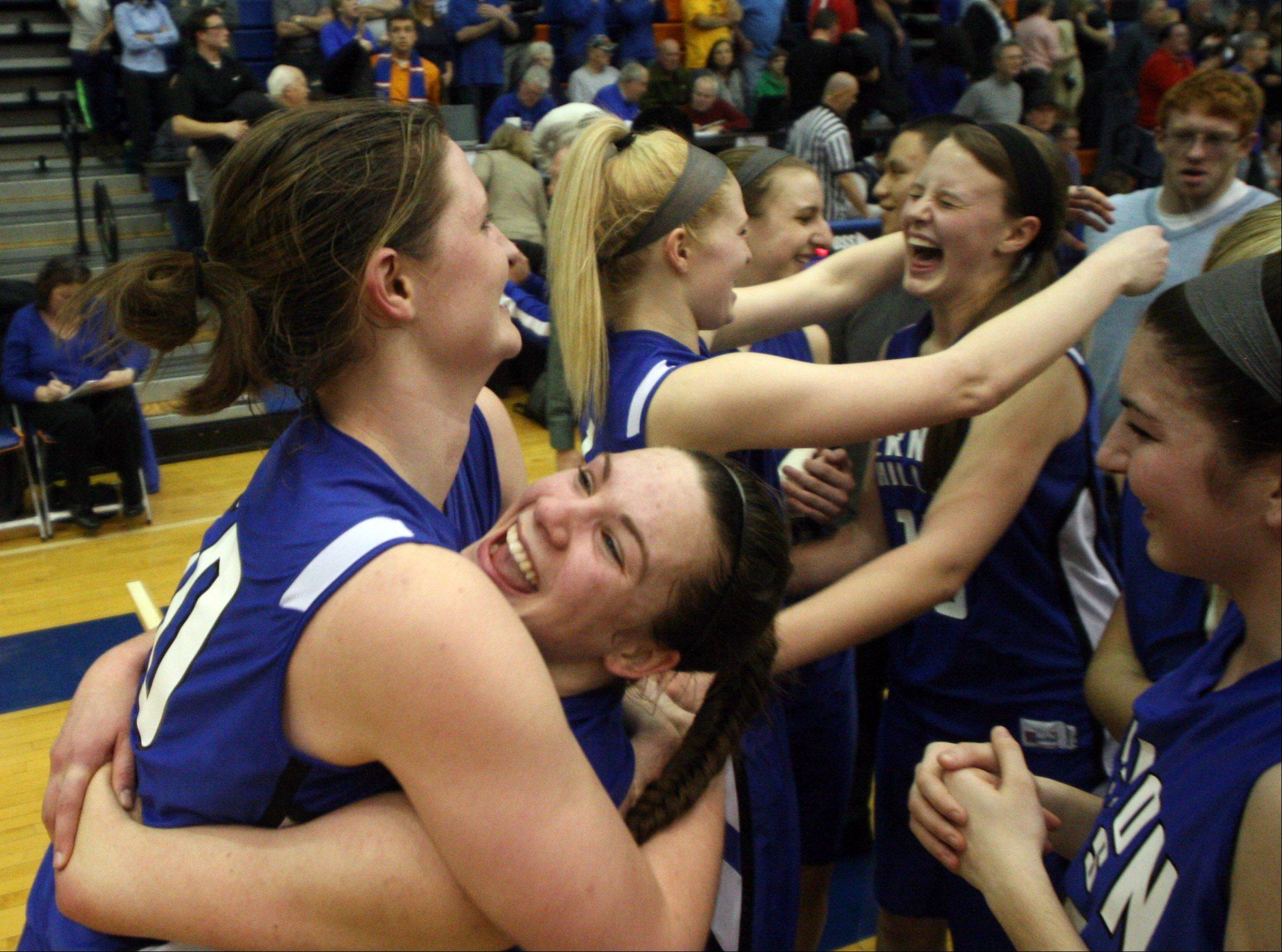 Vernon Hills players react after their 39-31 Class 3A supersectional victory over Burlington Central at Hoffman Estates High School on Monday night.