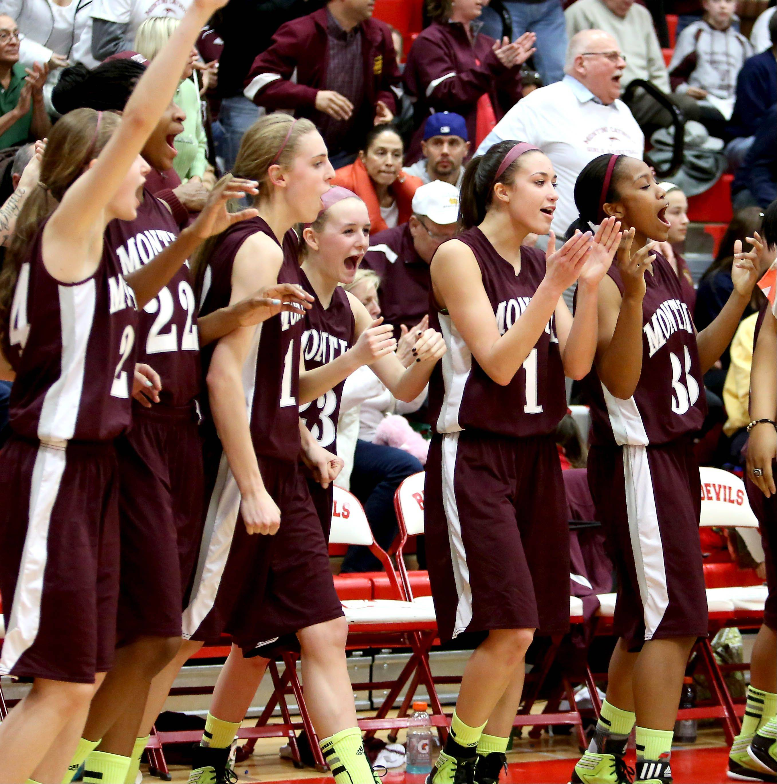 Montini players react to their win over Phillips.