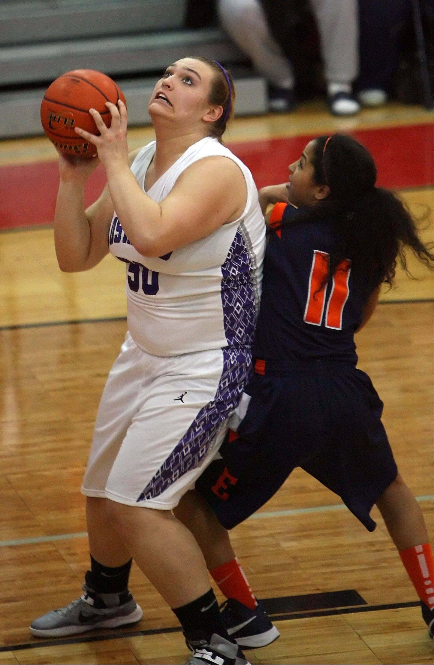 Rolling Meadows' Morgan Keller, left, drives on Evanston's Gabrielle Nottage.