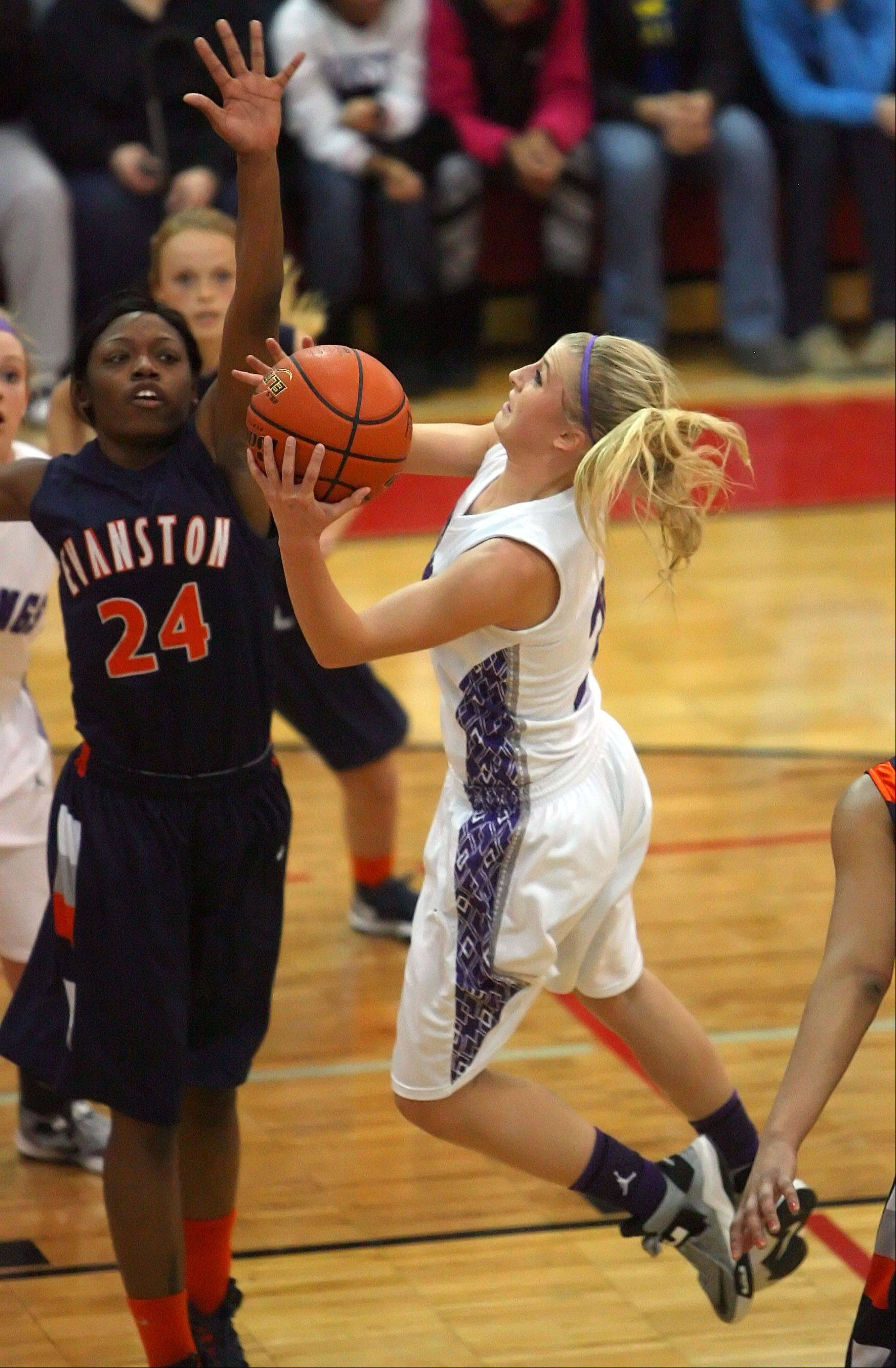 Rolling Meadows' Jackie Kemph, right, drives on Evanston's Sierra Clayborn.
