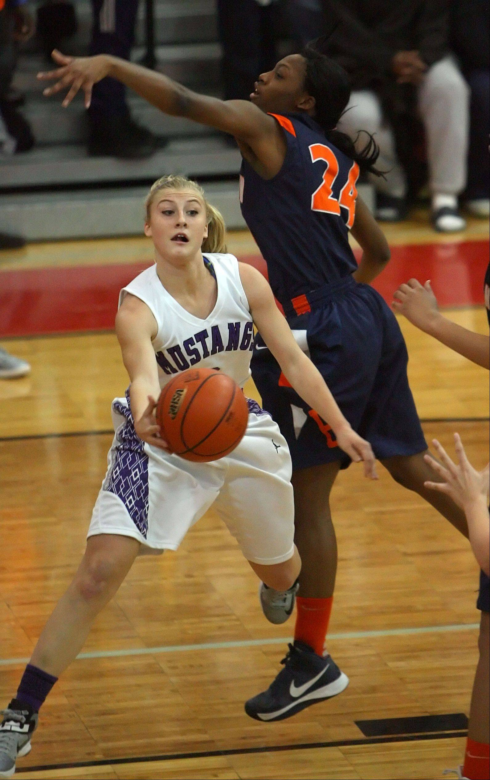 Rolling Meadows' Jackie Kemph drives on Evanston's Sierra Clayborn.