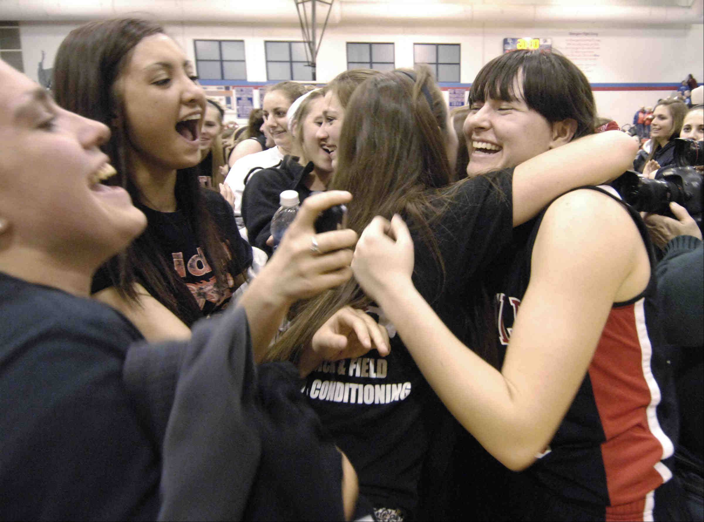 Huntley's Bethany Zornow is hugged by fans.
