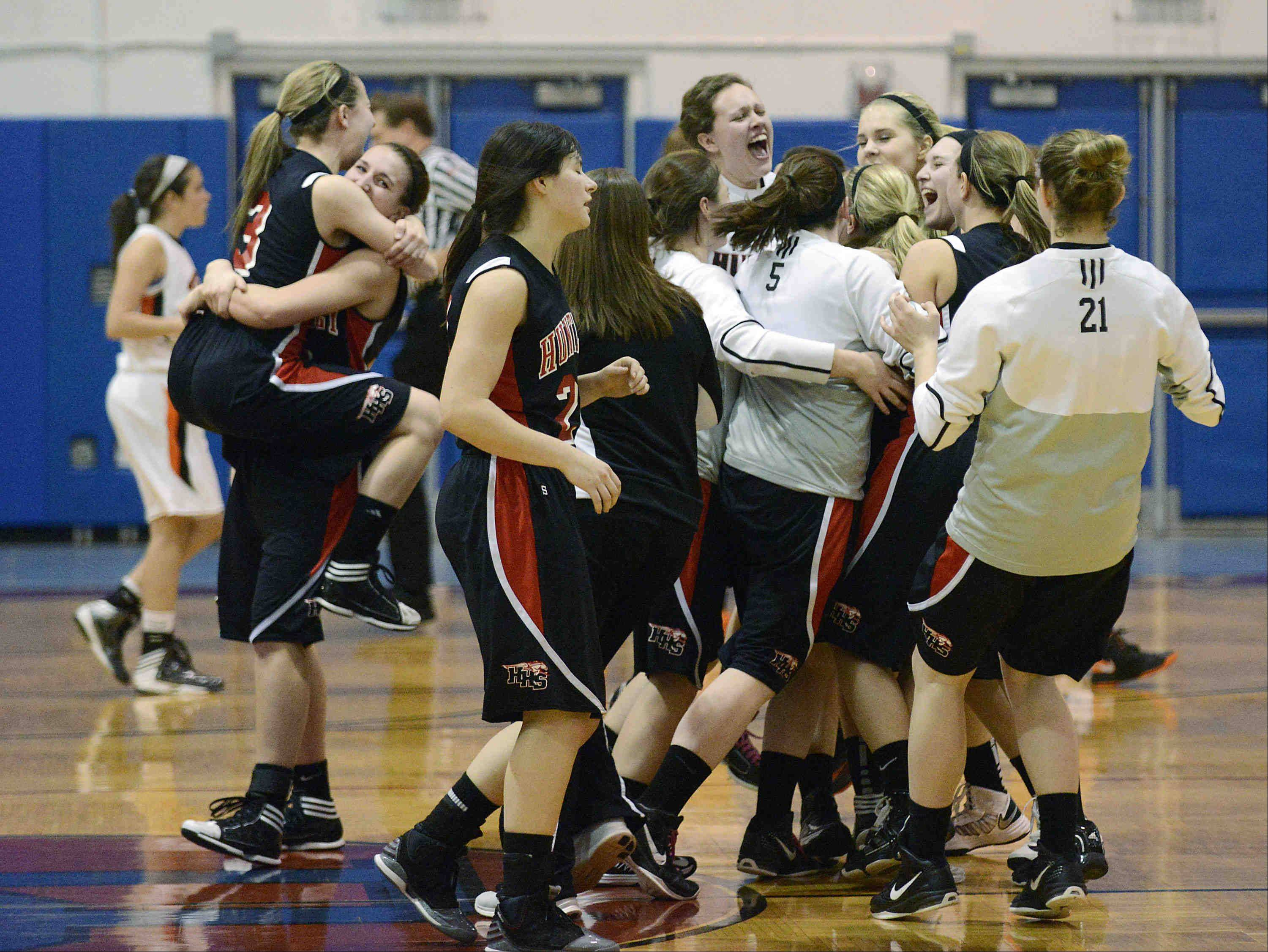 Huntley players celebrate their Class 4A Dundee-Crown supersectional win.