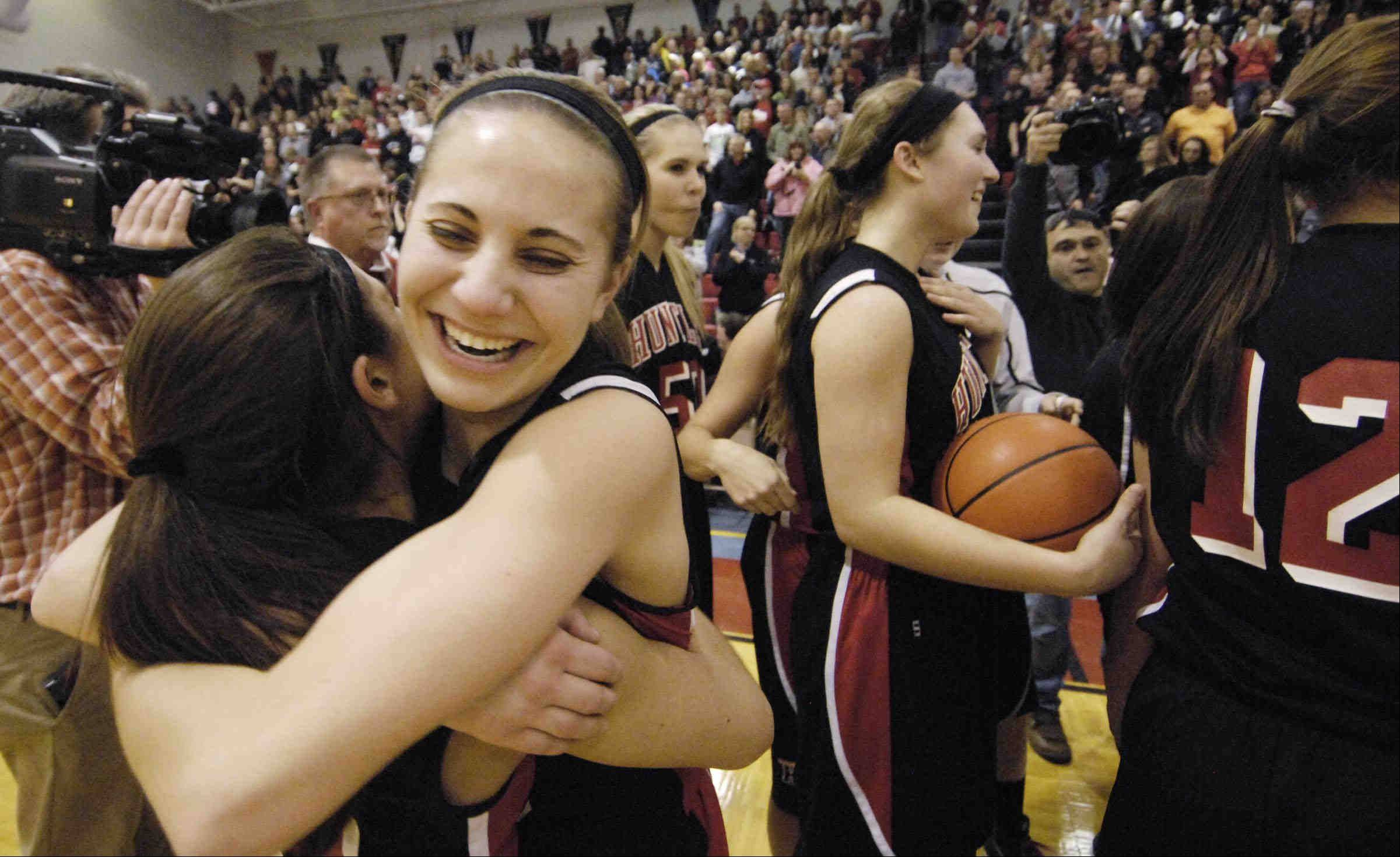 Huntley's Amanda Kaniewski laughs with teammate Kayla Barreto after their win.